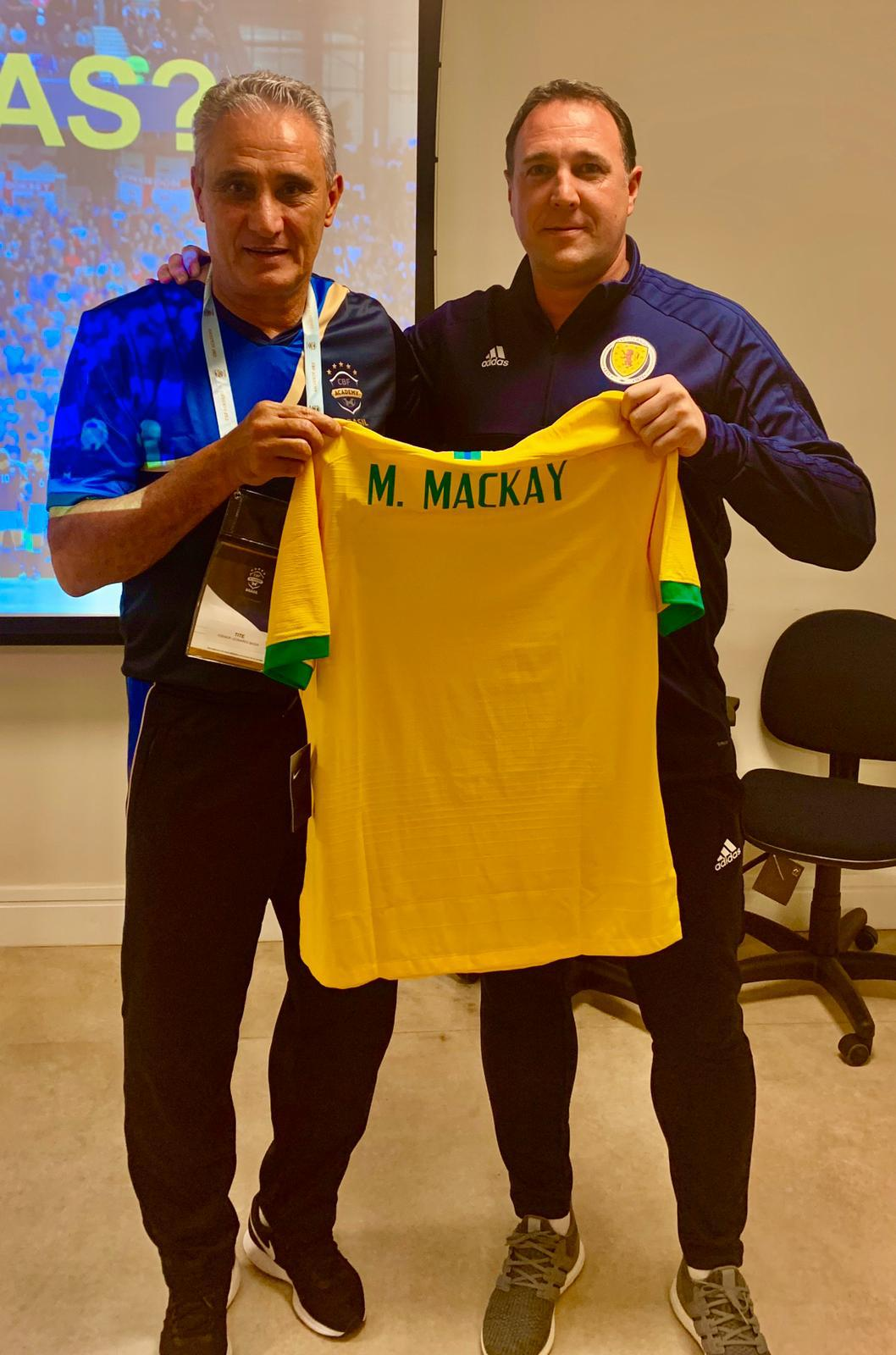 Malky Mackay presented with Brazil shirt by boss Tite
