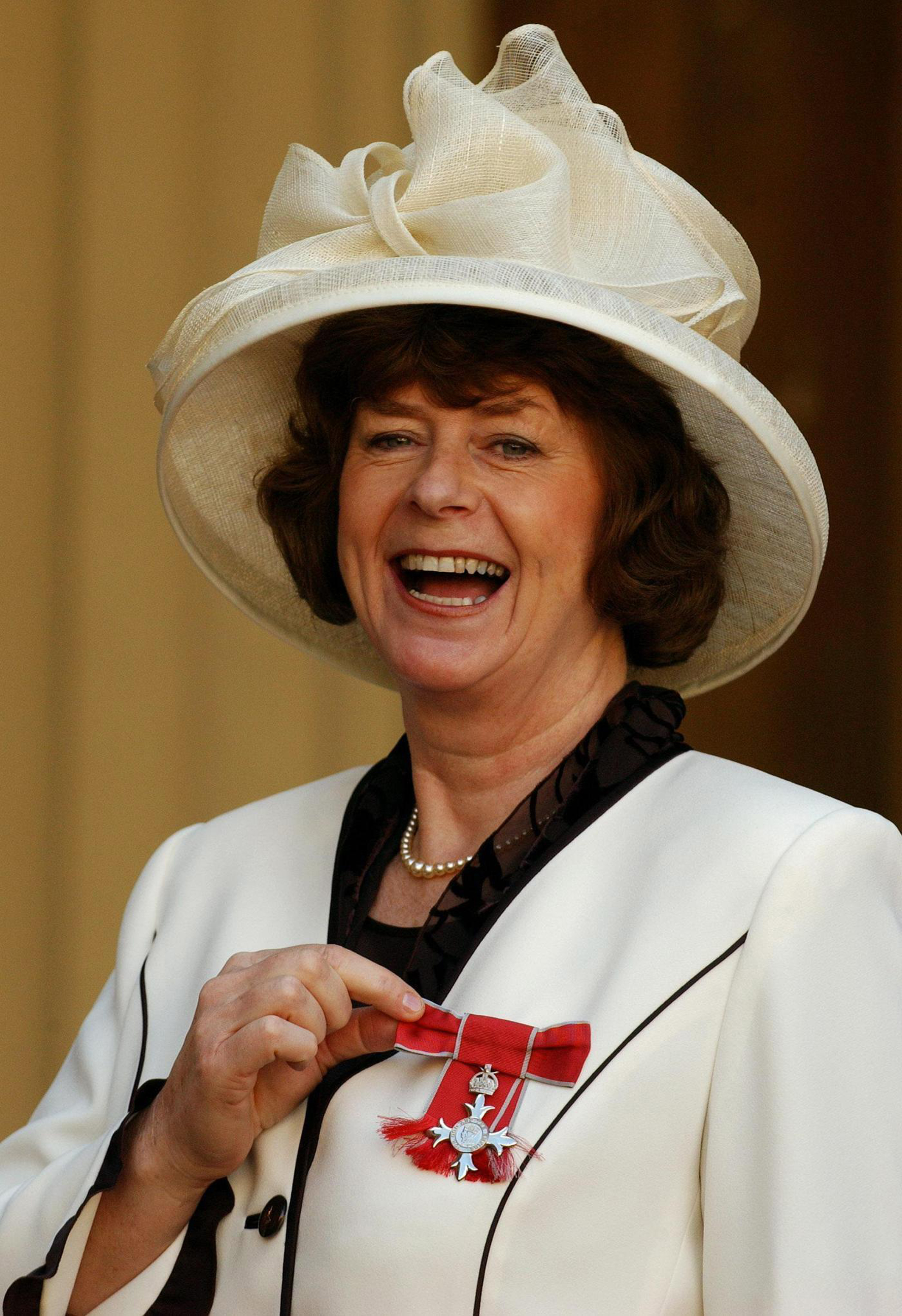 Poet Pam Ayres at Buckingham Palace, after collecting her MBE's for sevices to literature and entertainment from the Queen in 2004 (Fiona Hanson/PA)