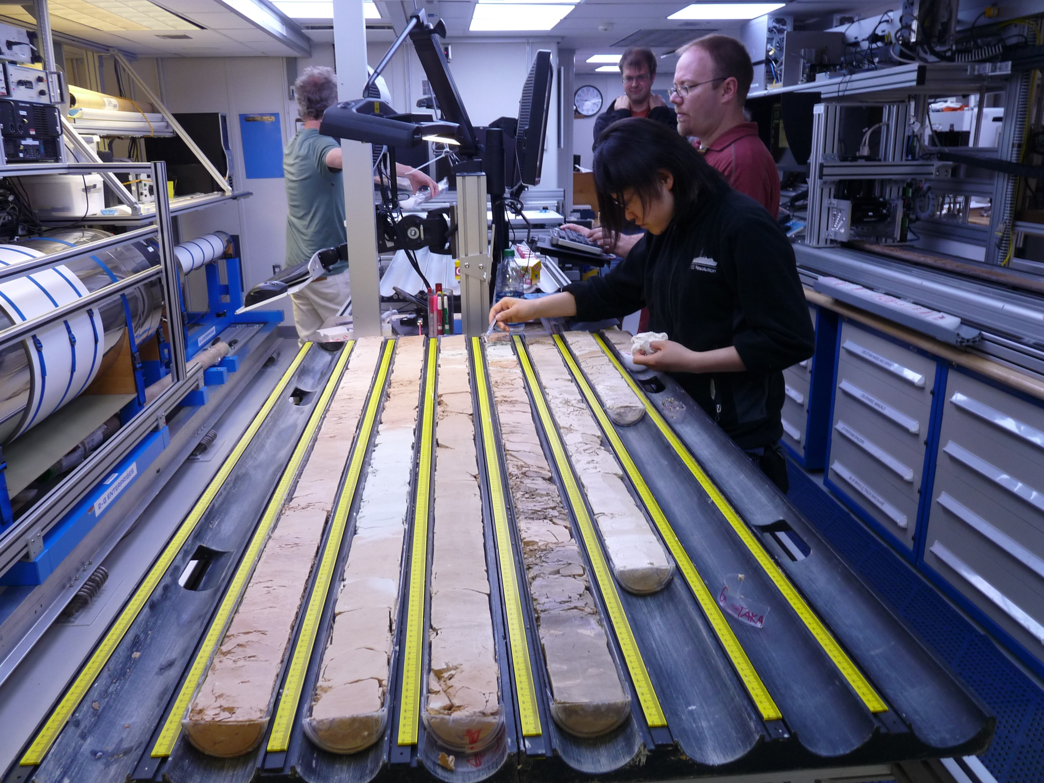 Researchers analysing ocean sediment samples.