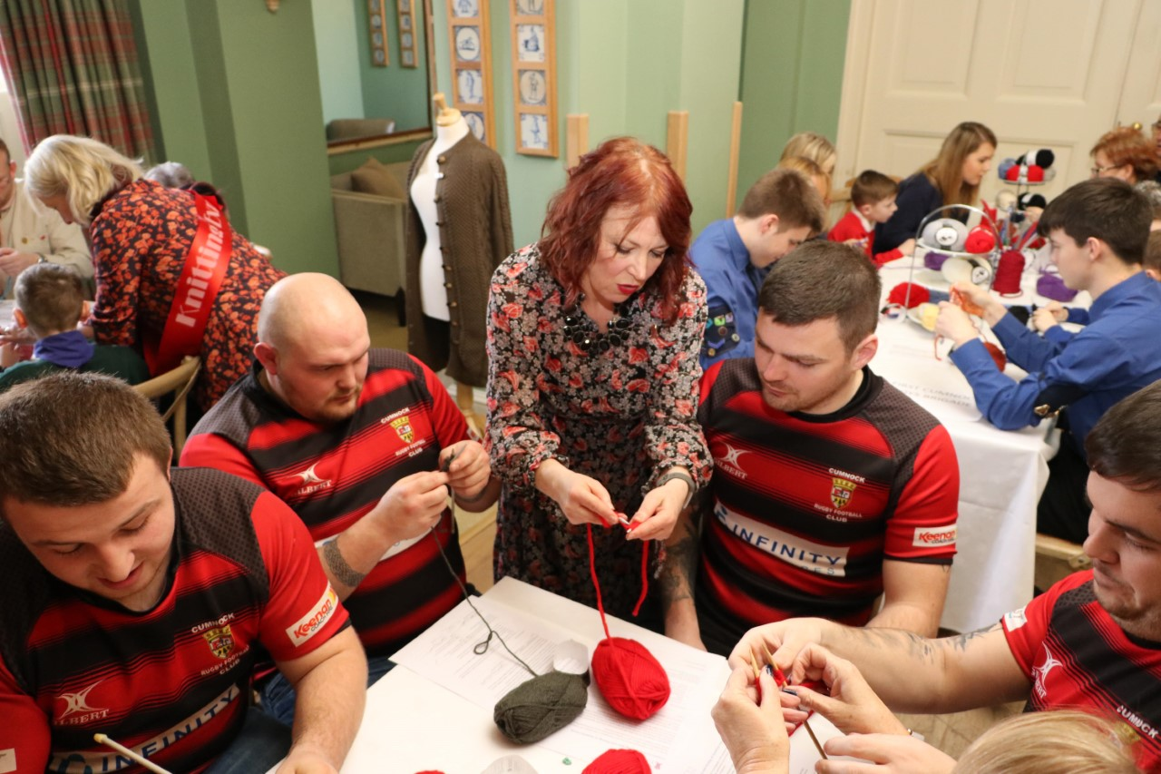 Rugby players taught to knit