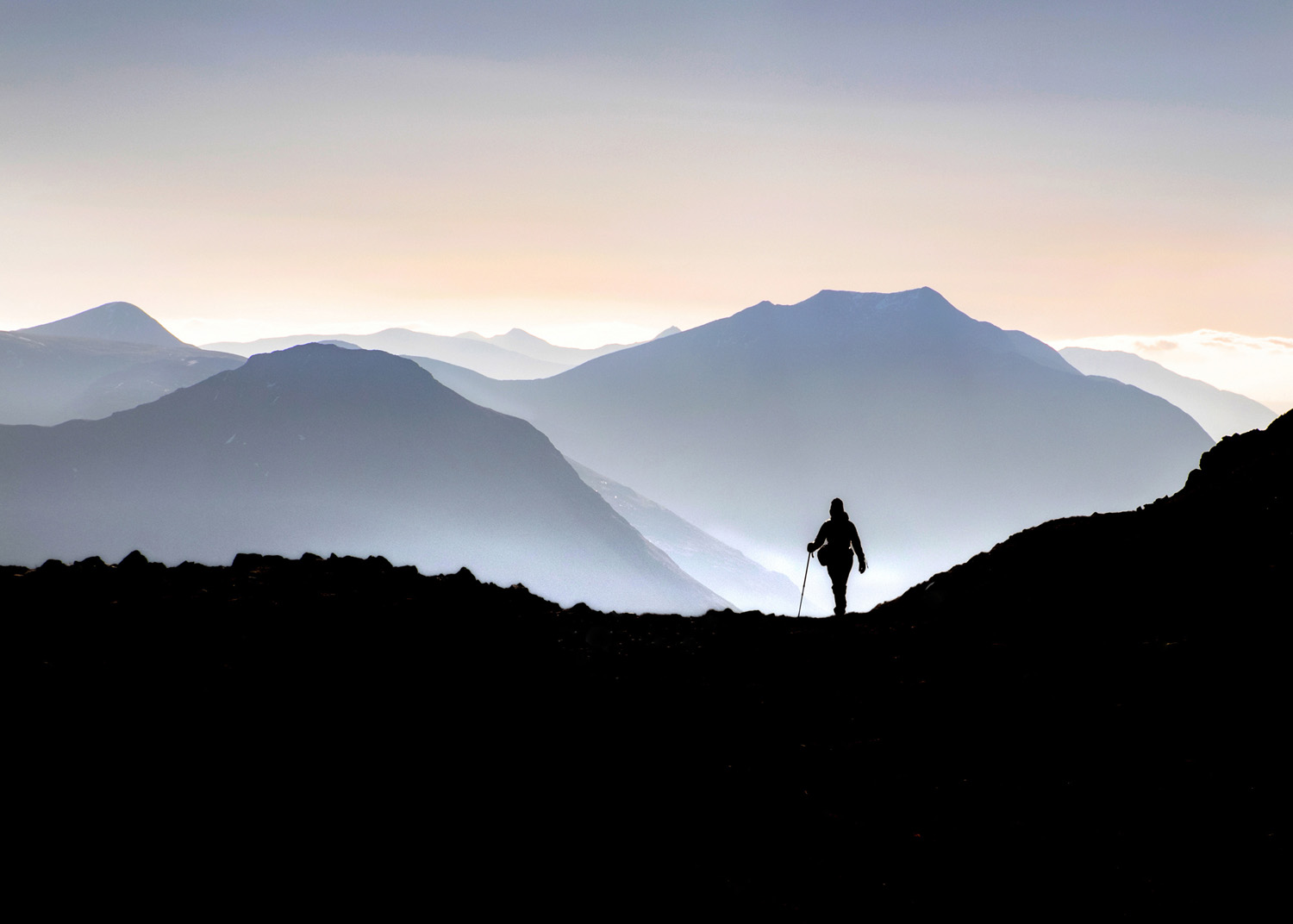 A lone hiker in the highlands