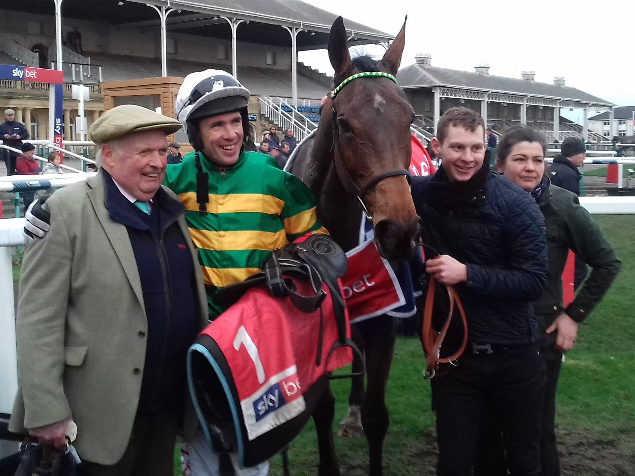 Derek O'Connor poses with OK Corral and team after his Sky Bet Chase win (Keith Hamer/PA)