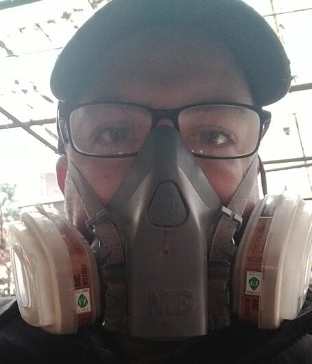 Chris Hill, 38, wearing a gas mask