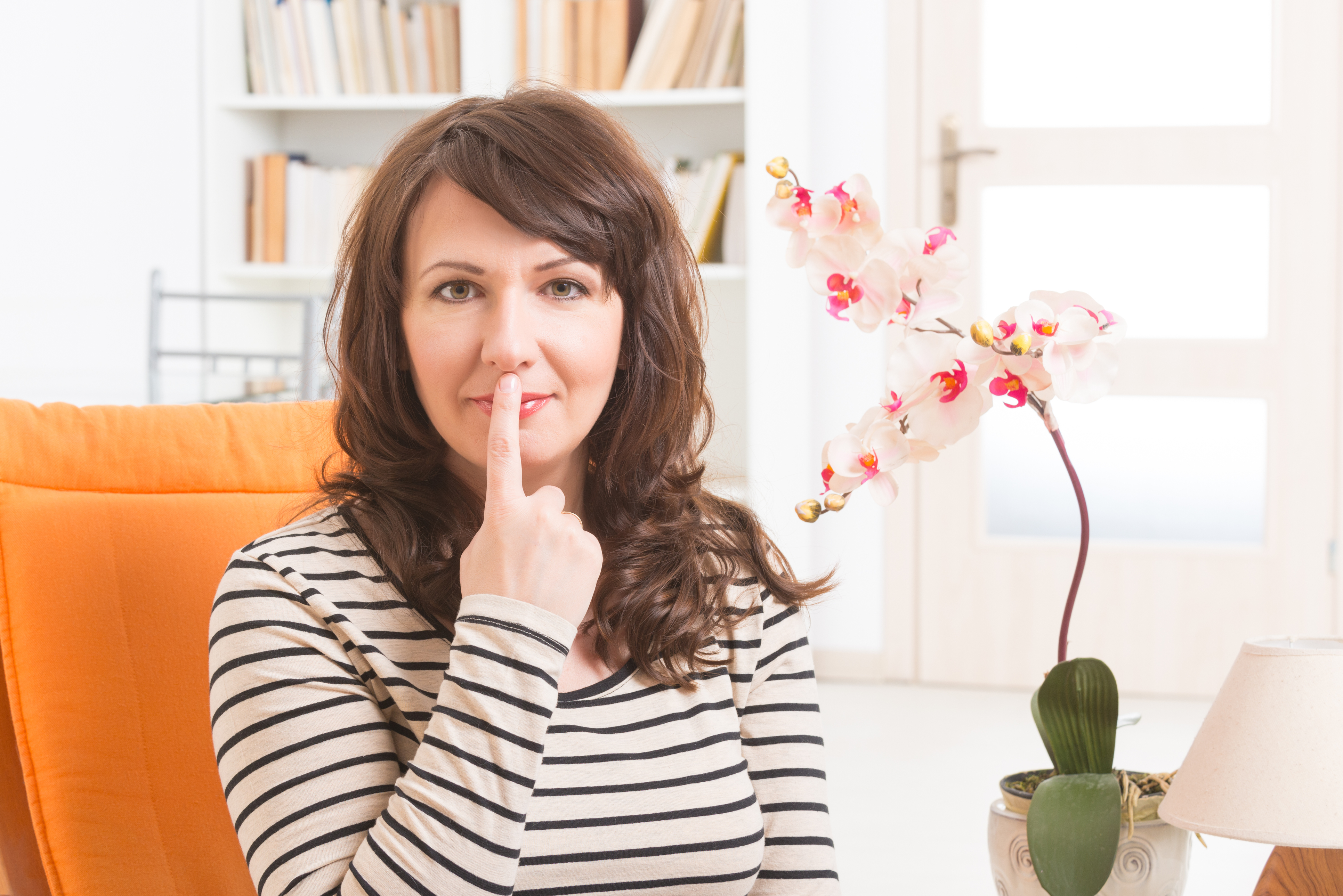 Woman doing EFT on the under nose point. Emotional Freedom Techniques, tapping, a form of counseling intervention that draws on various theories of alternative medicine.