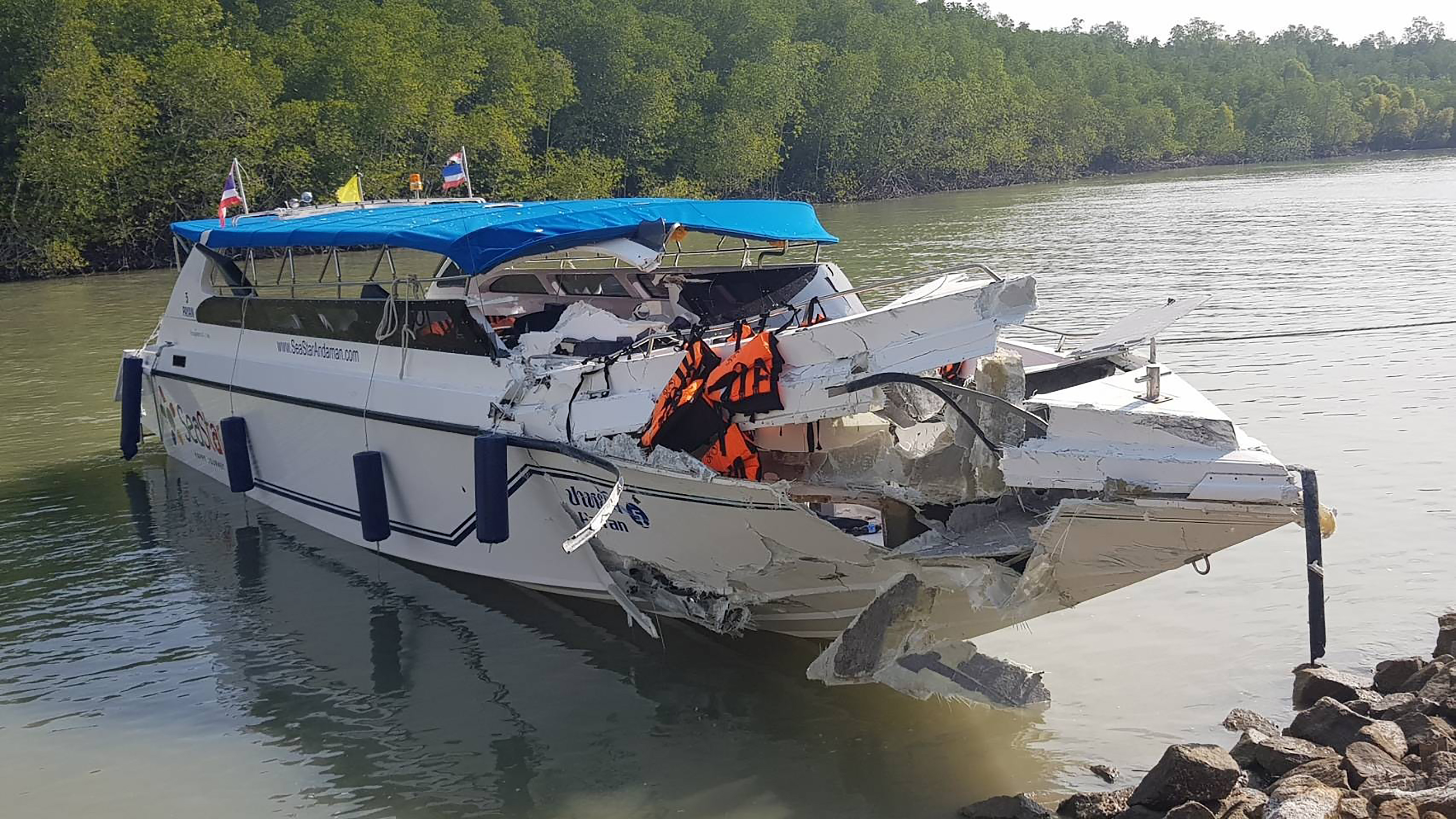 A speedboat used for tourists is heavily damaged after it collided with another speedboat off the Thai resort island of Phuket