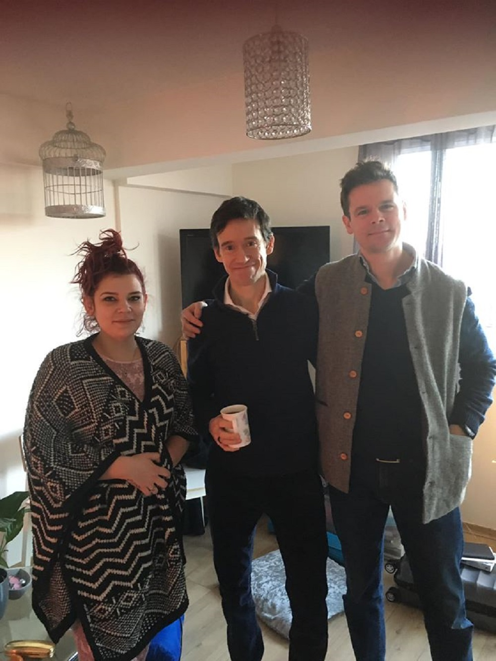 Rory Stewart spoke with volunteer Ria (left) during his stay at Lorraine Tabone's flat