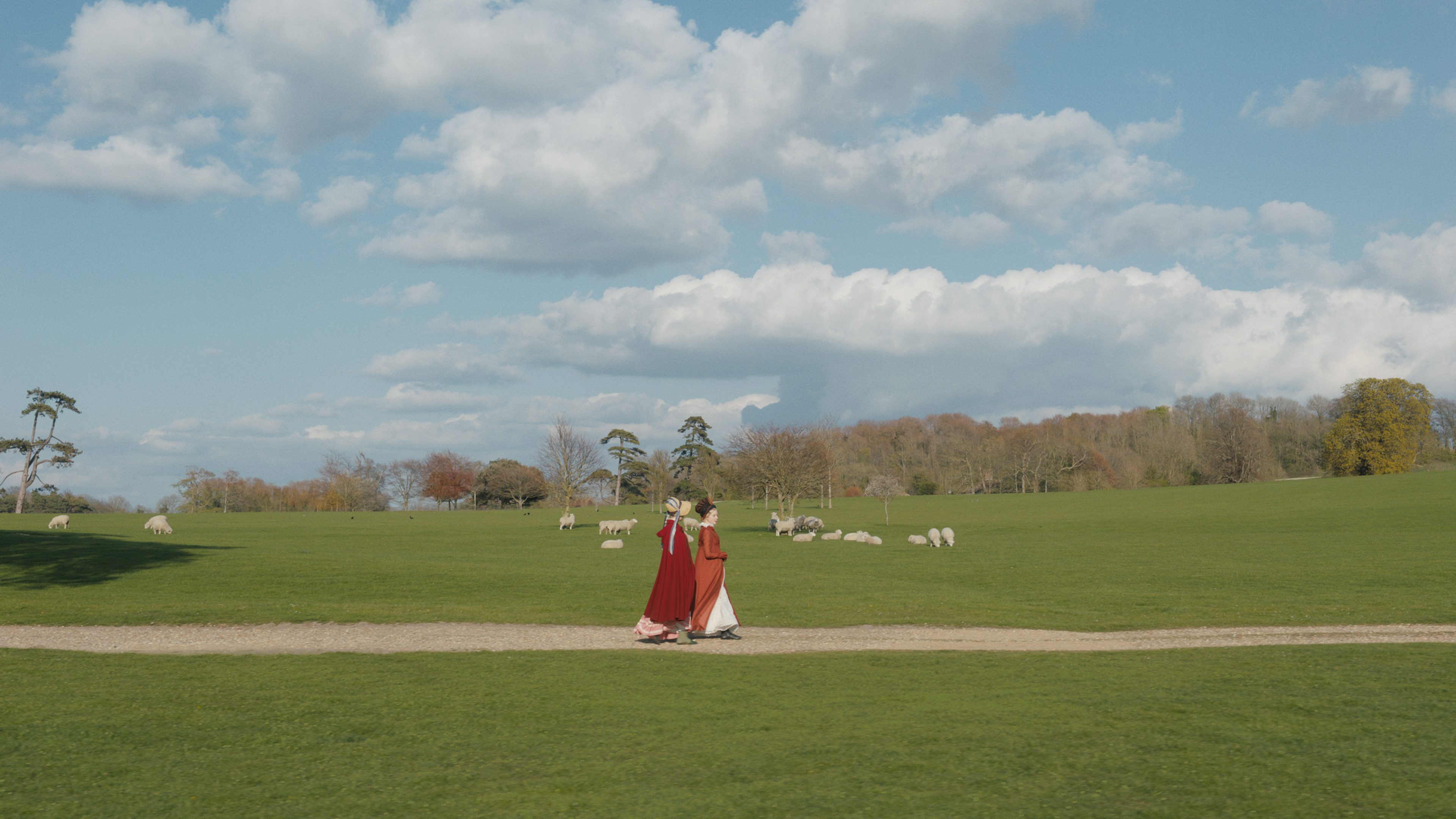 Mia Goth and Anya Taylor-Smith amidst the lambs in Emma