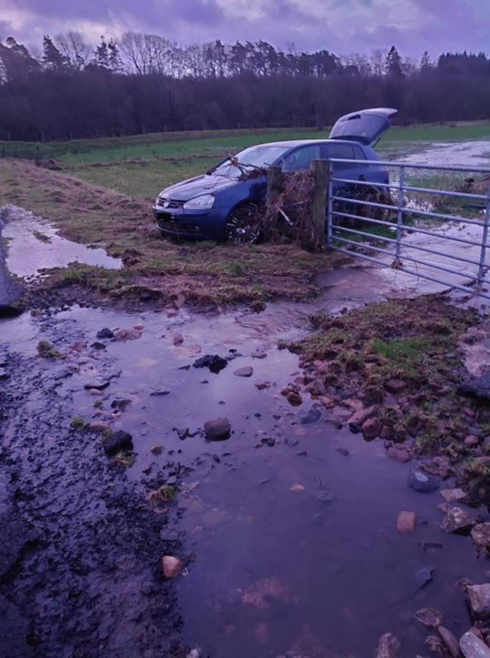 A car was swept off the road by floodwater during Storm Dennis