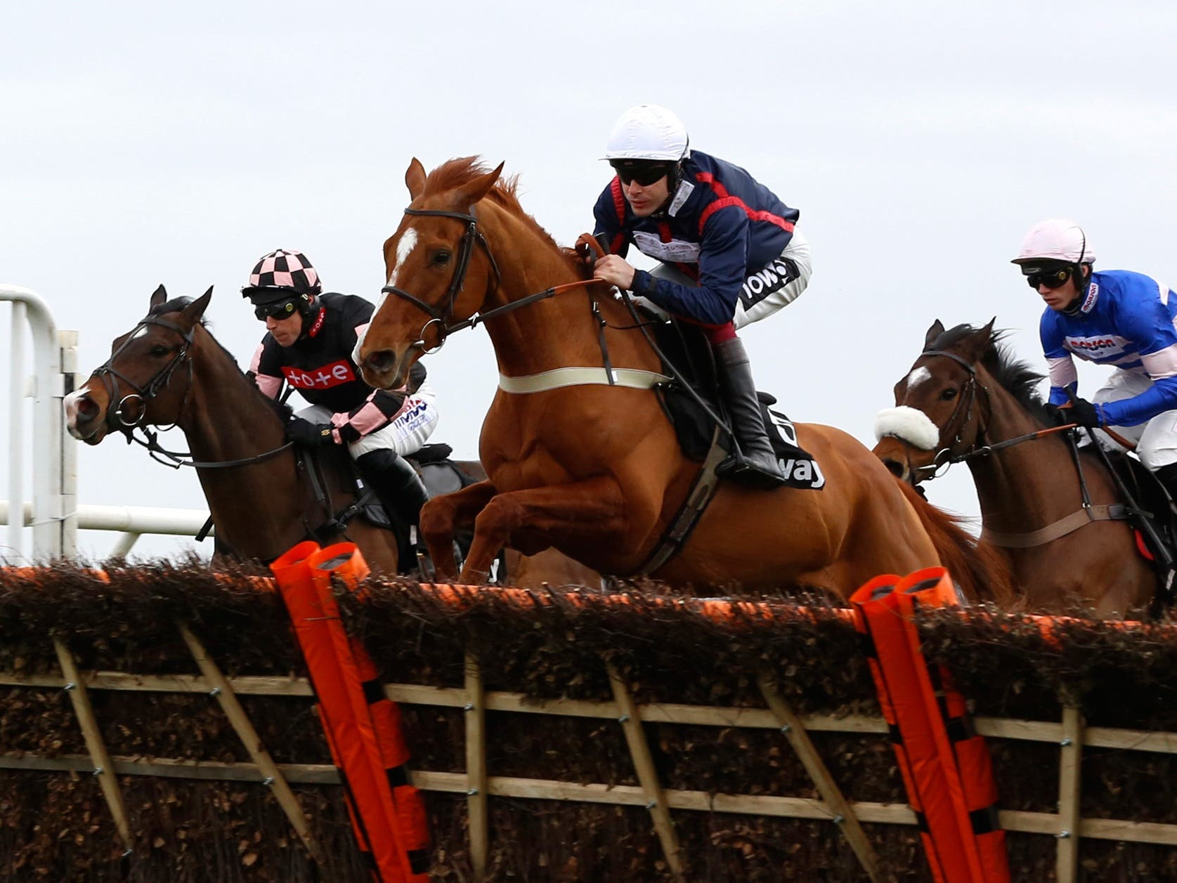 Song For Someone (centre) on his way to winning at Kempton (Julian Herbert/PA)