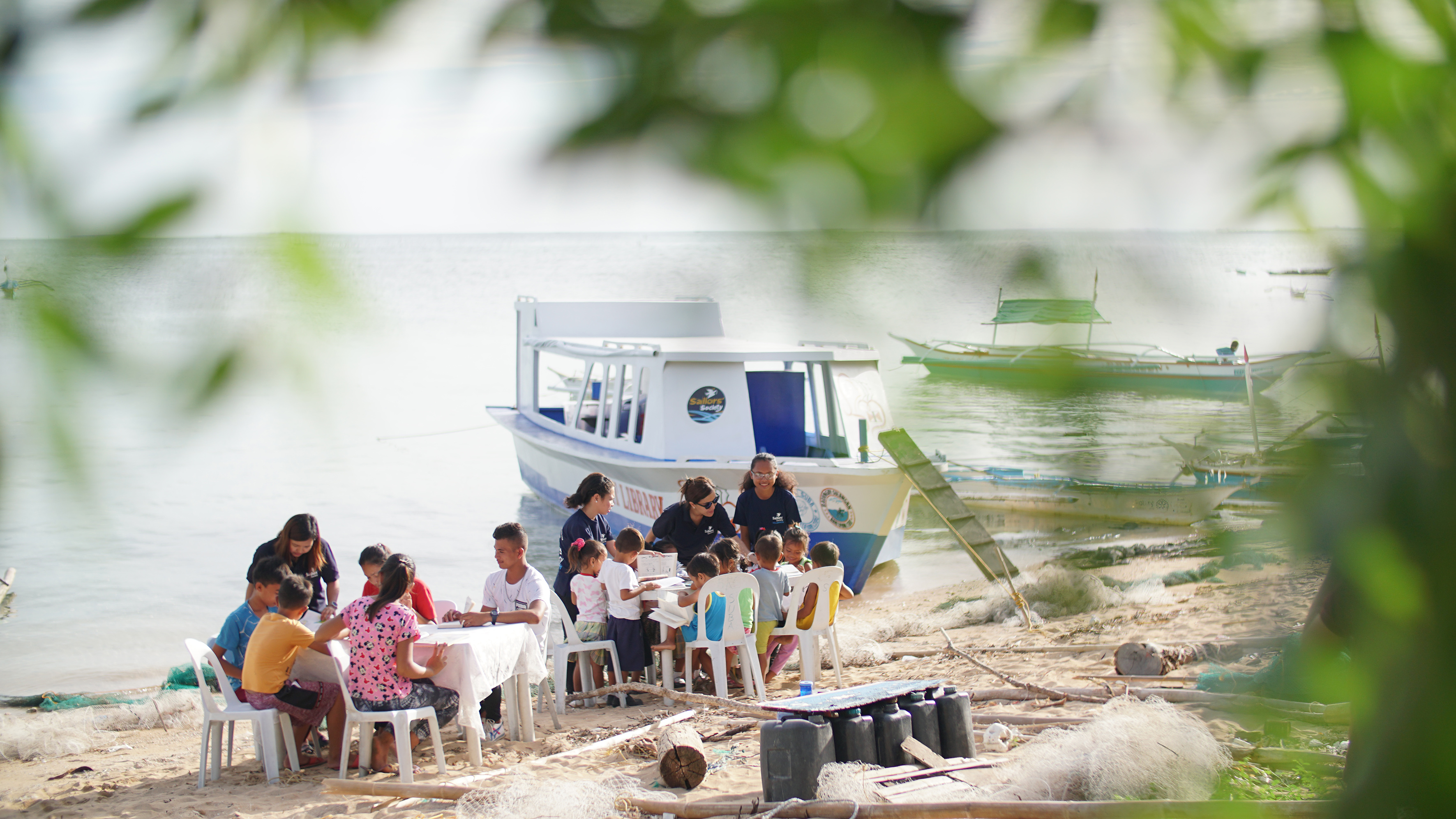 Pupils on Bantayan Island, the Philippines, use Sailors' Society's boat library