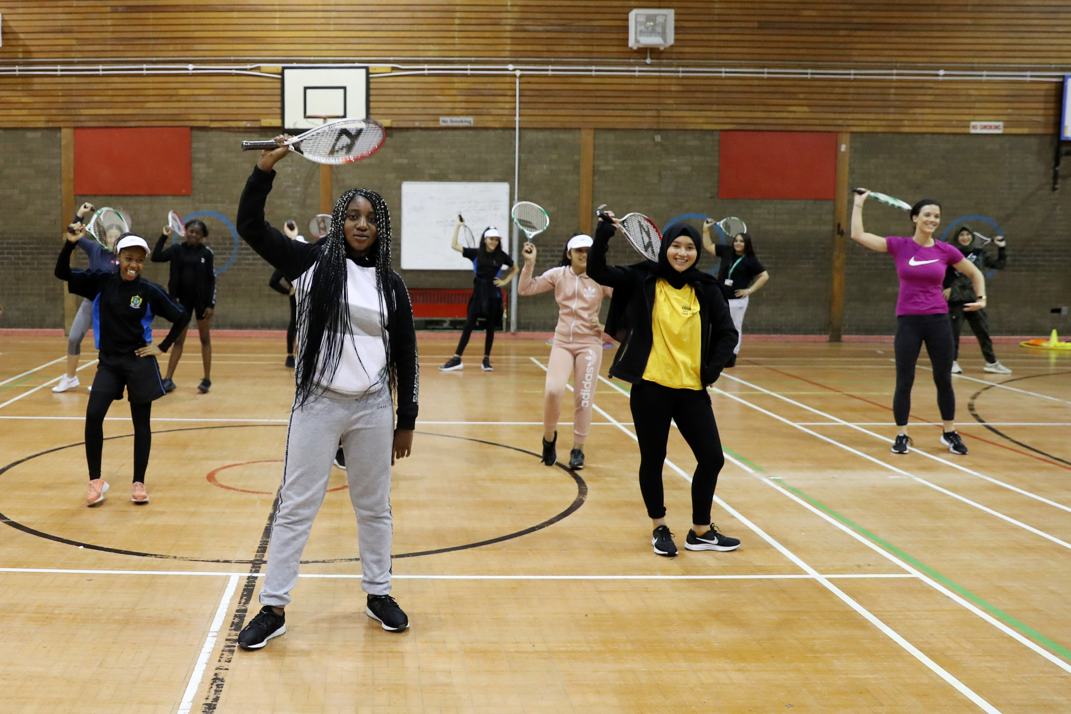 Women and girls take part in a She Rallies/SERVES workshop