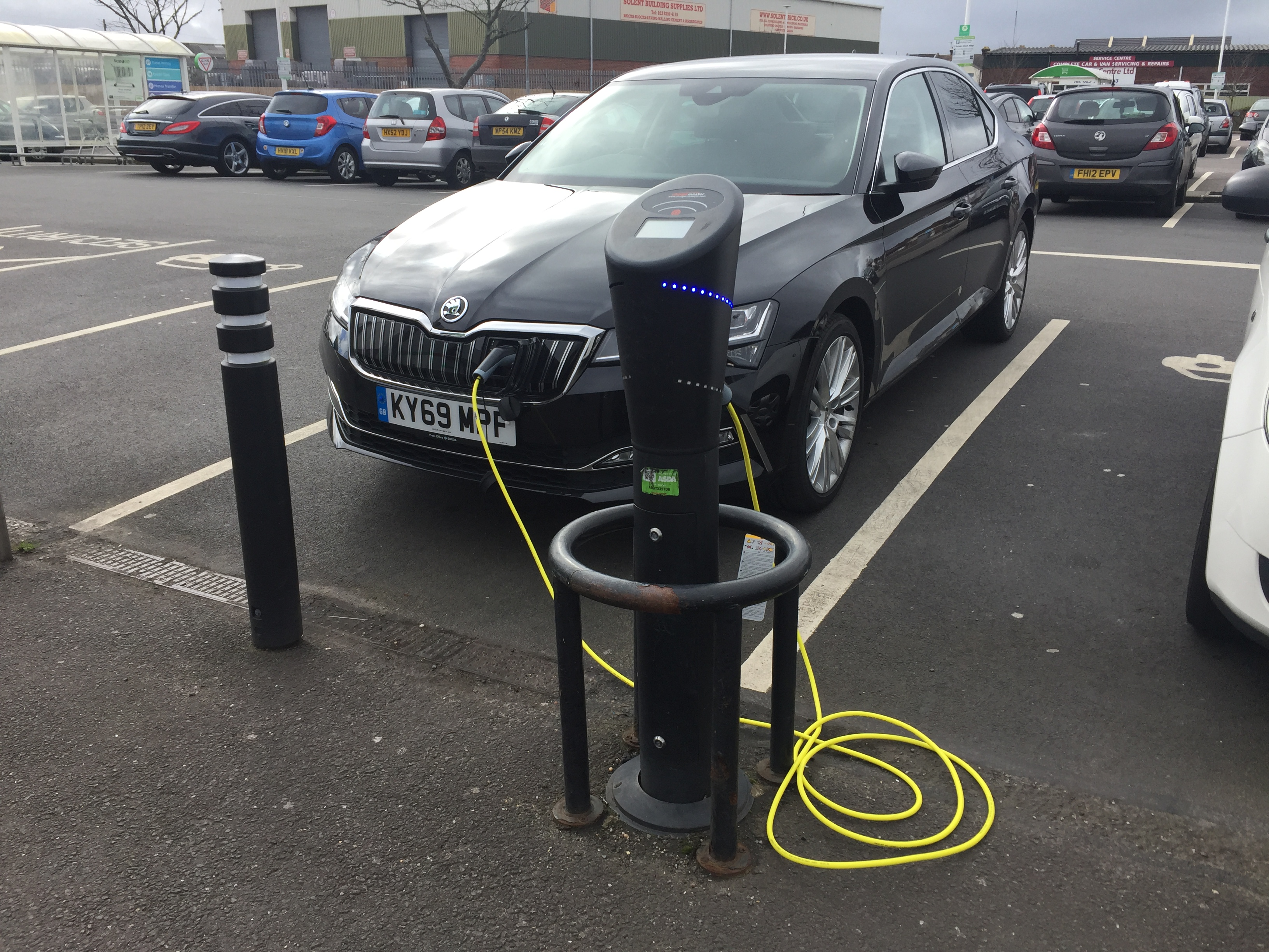 Skoda Superb attached to charging point