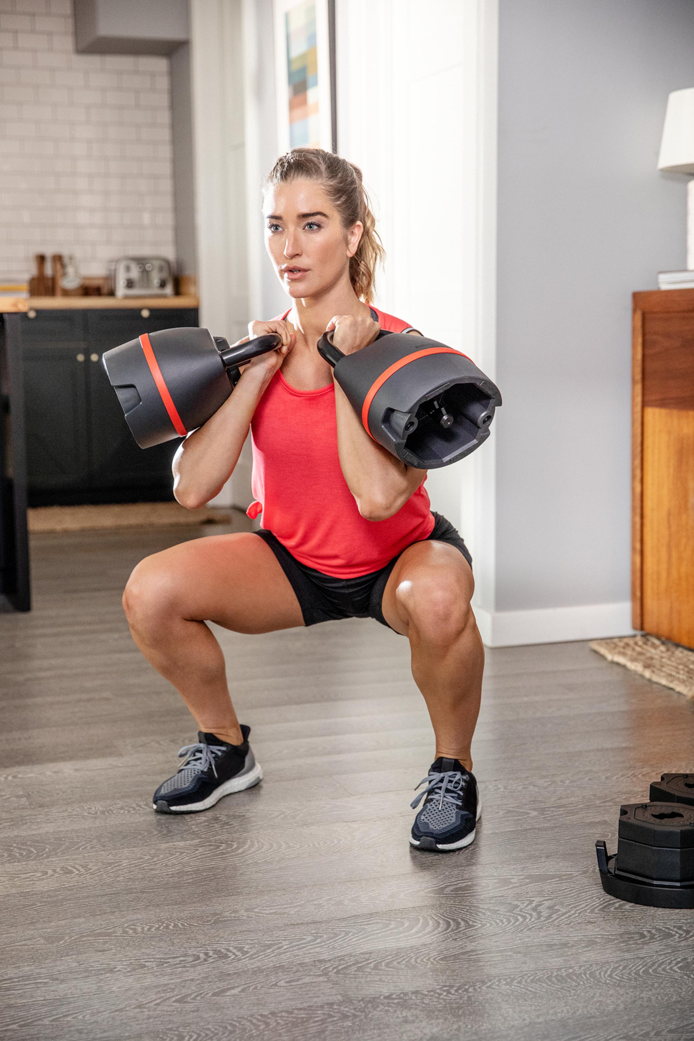A woman using the Bowflex kettlebells