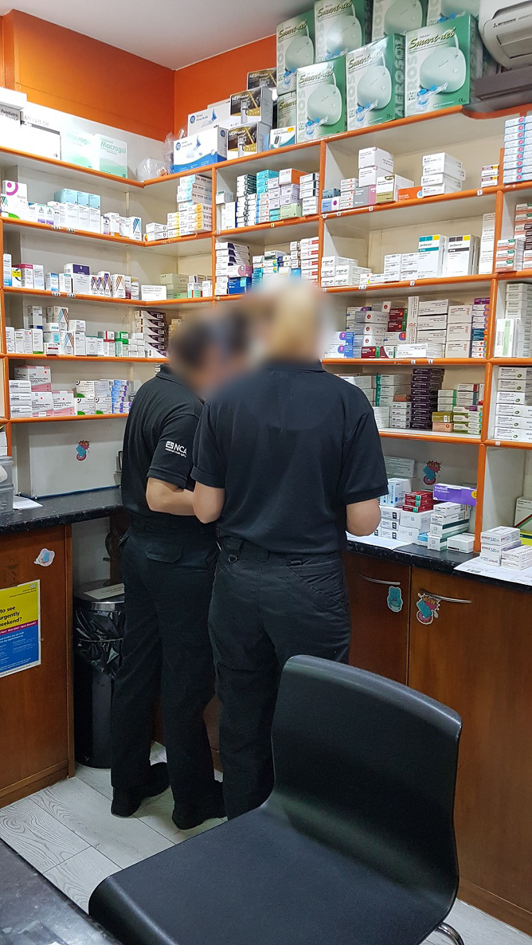 NCA officers search a pharmacy in south London