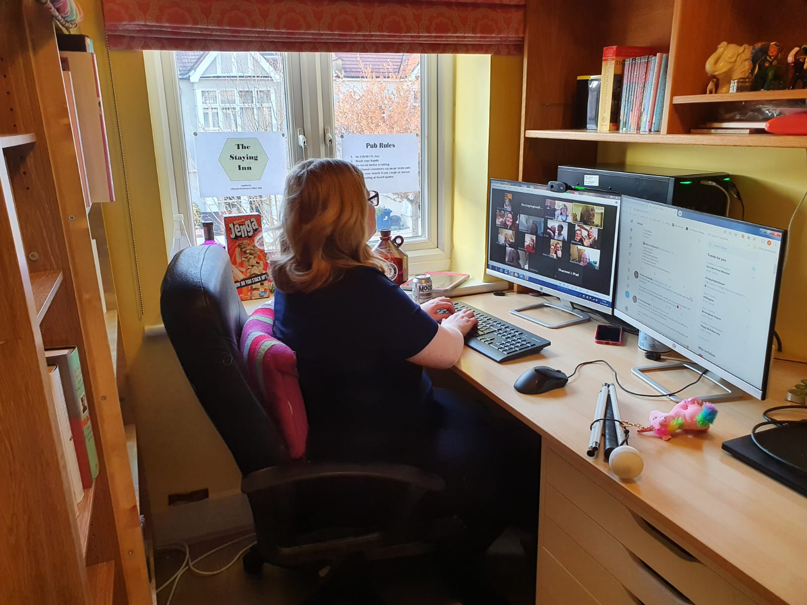 Dr Amy Kavanagh, a visually impaired activist, at her desk where she runs most of The Staying Inn's events