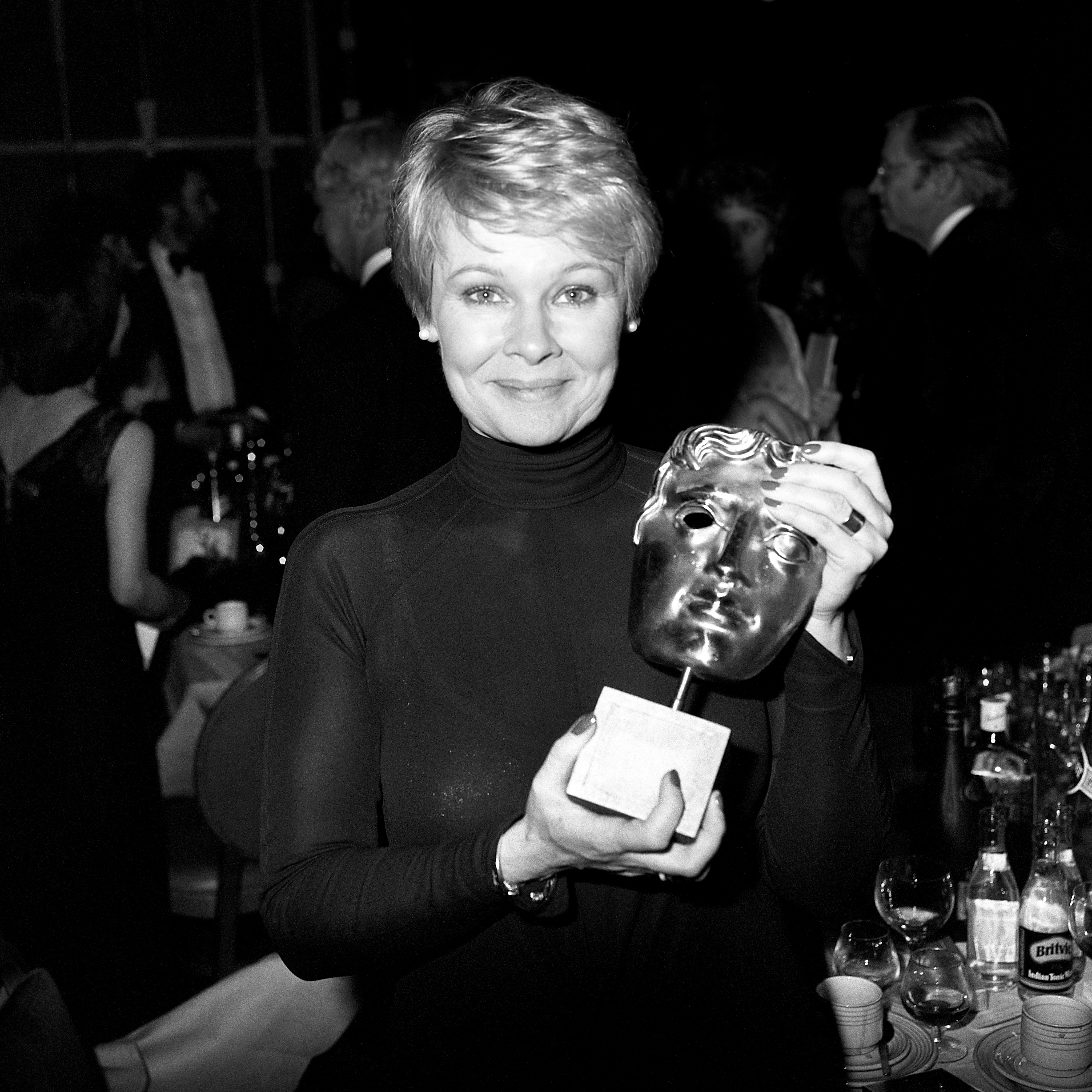 Judi Dench in 1082, with her Bafta TV award for Best Actress for 'A Fine Romance', at the British Academy of Film and TV Arts Awards