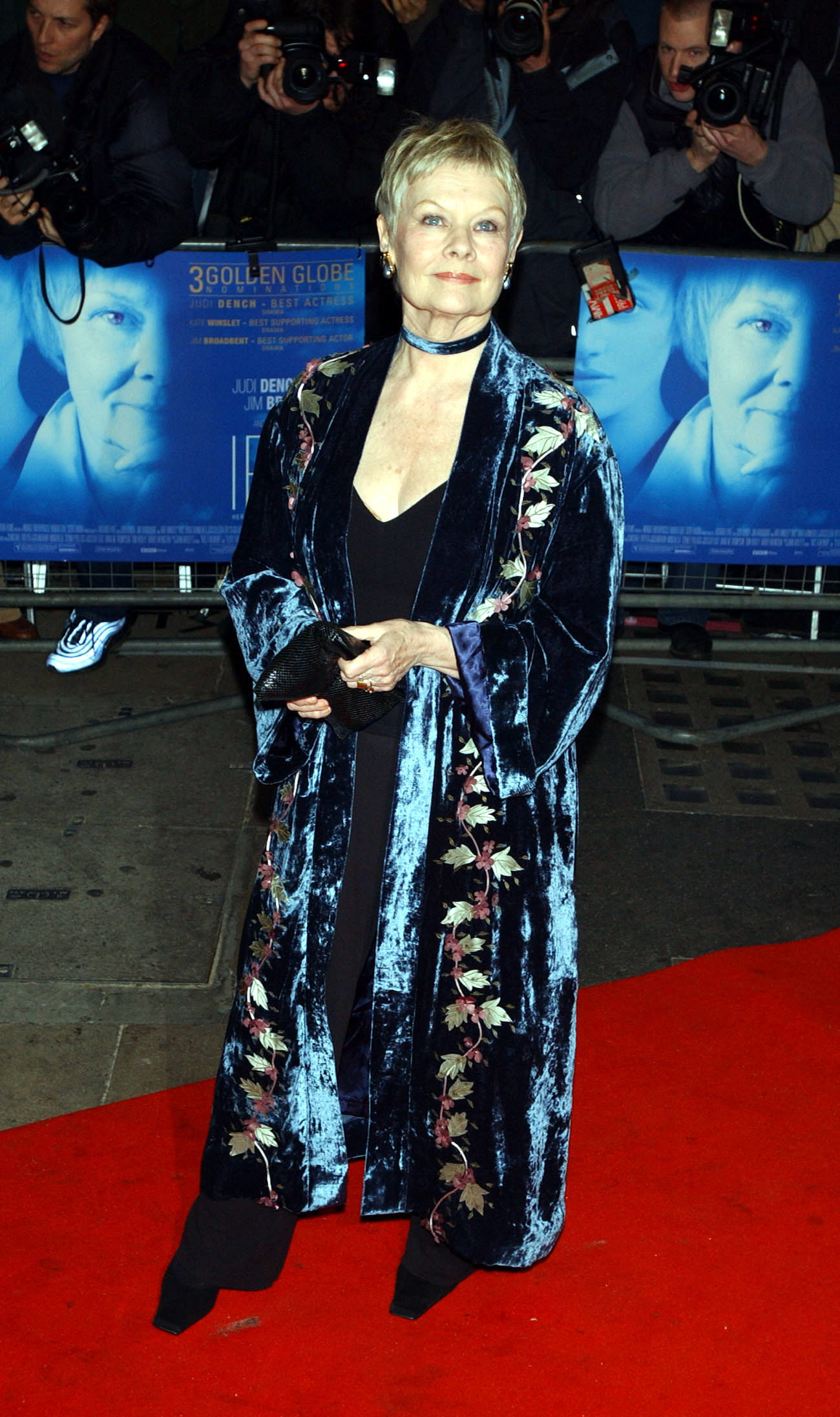Dame Judi Dench arrives at the Curzon Mayfair in central London, for the premiere of 'Iris'. The film follows the story of Booker Prize-winning novelist and philosopher Iris Murdoch who died in 1999, played by Kate Winslet and Judi Dench. 2002