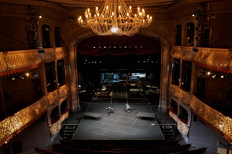 The actors in an empty auditorium