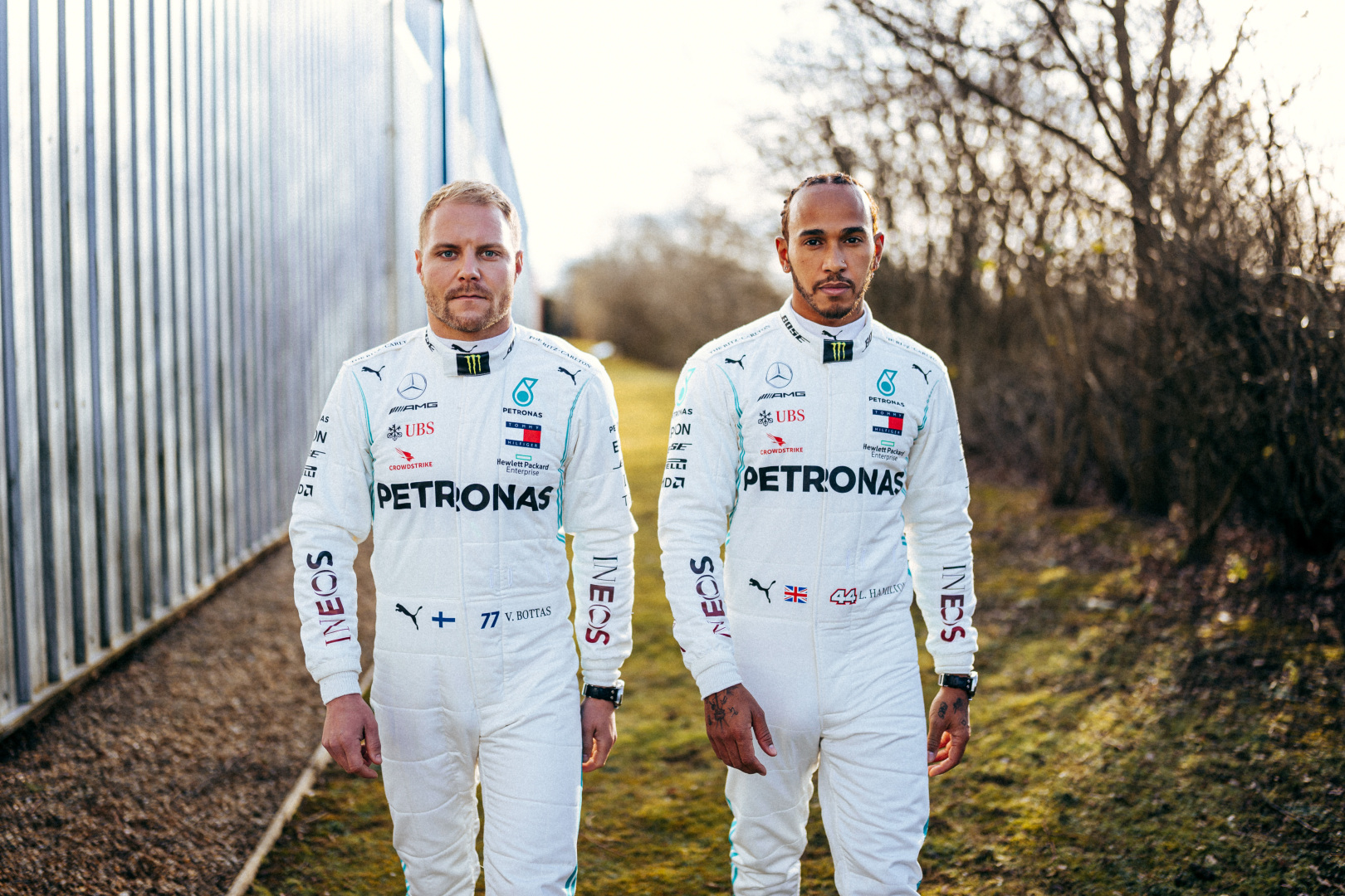 Mercedes F1 drivers Valtteri Bottas (l) and Lewis Hamilton