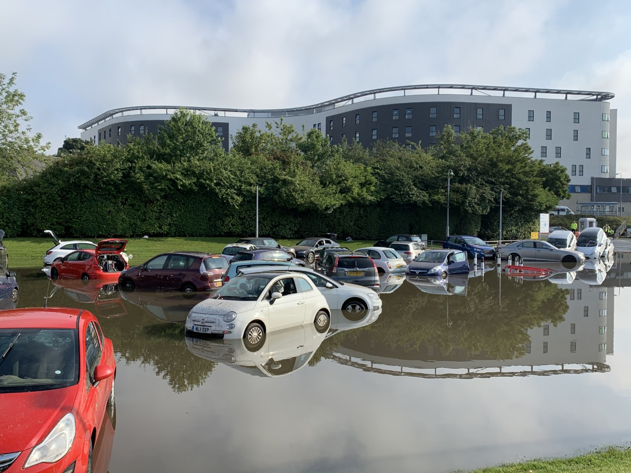 cars partially submerged in floodwater