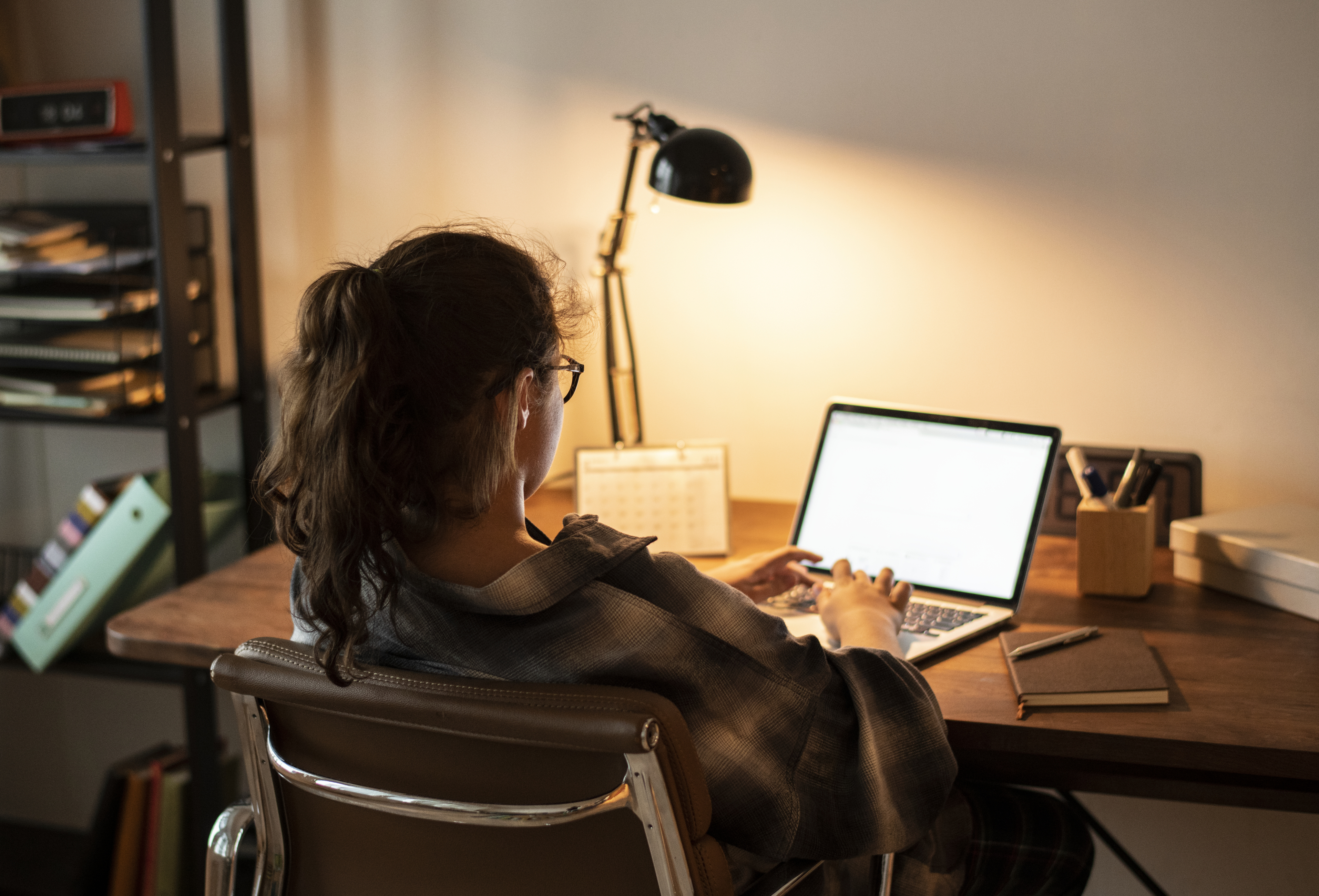 Woman sitting down at her laptop