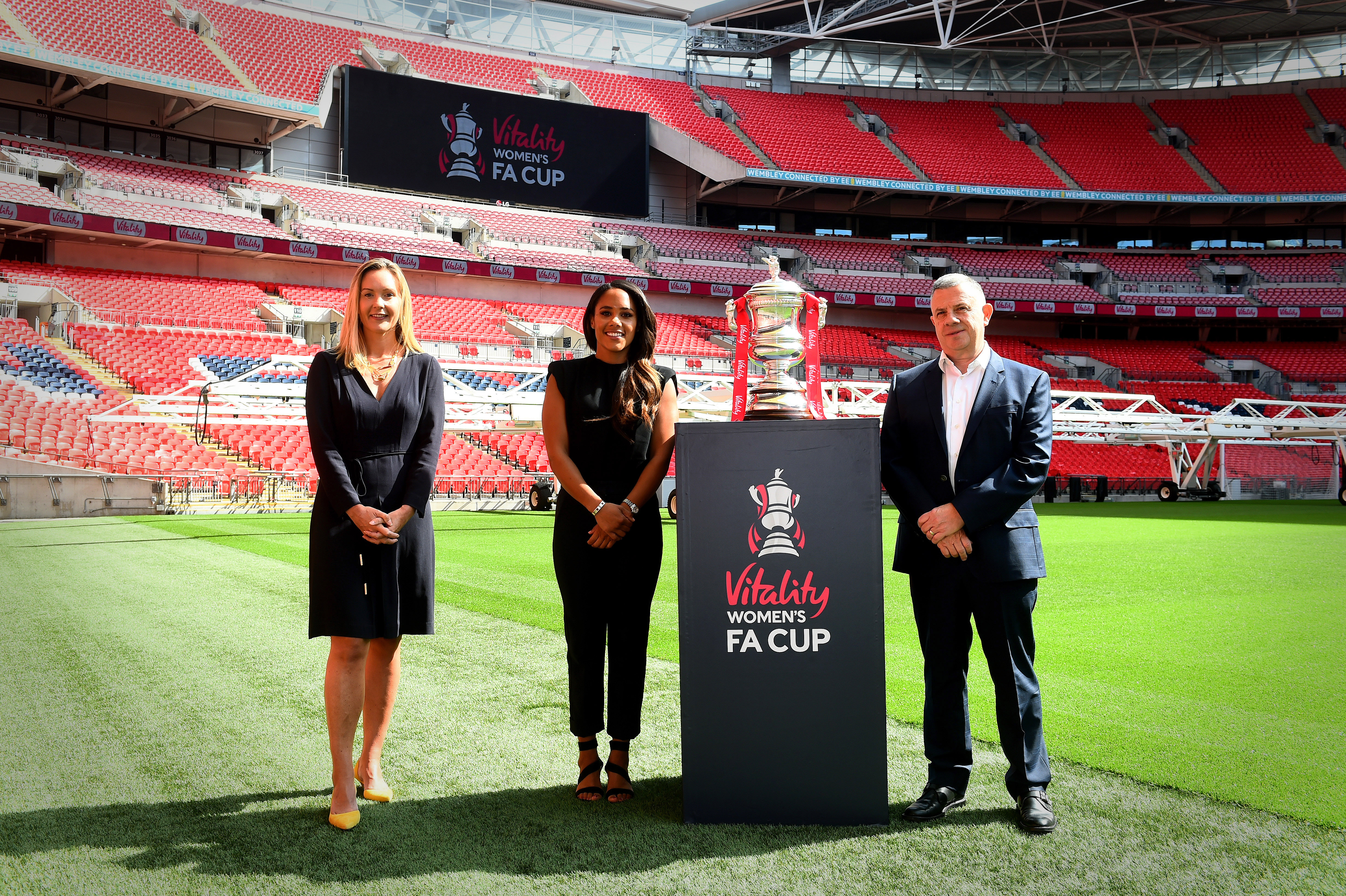 Alex Scott, centre, is an ambassador for Vitality, which has struck a deal to sponsor the Women's FA Cup. The former England defender is pictured alongside Vitality CEO Neville Koopowitz, right, and the FA marketing director Kathryn Swarbrick