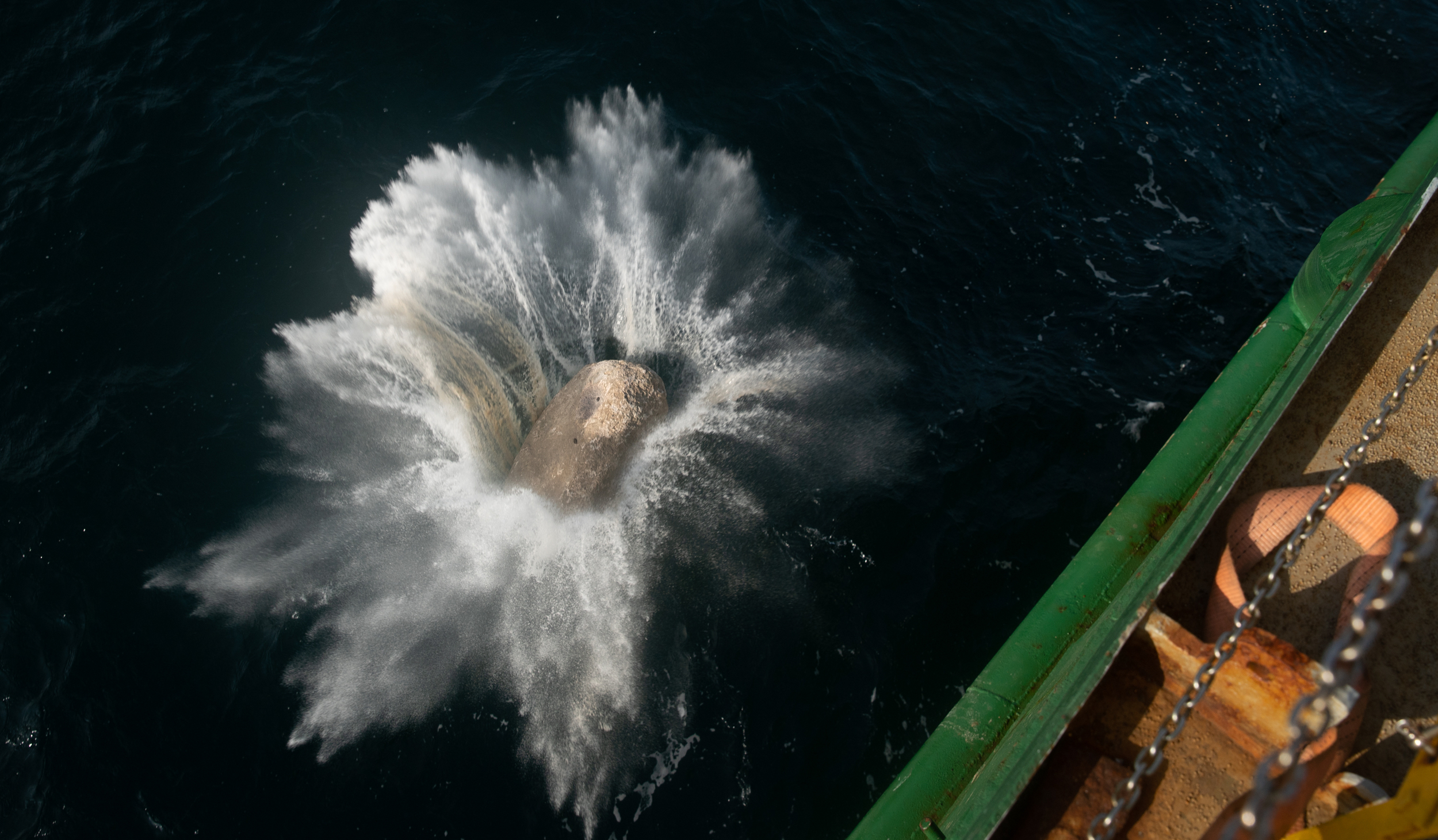 The boulders are being dropped from Greenpeace vessel Esperanza (Suzanne Plunkett/Greenpeace/PA)