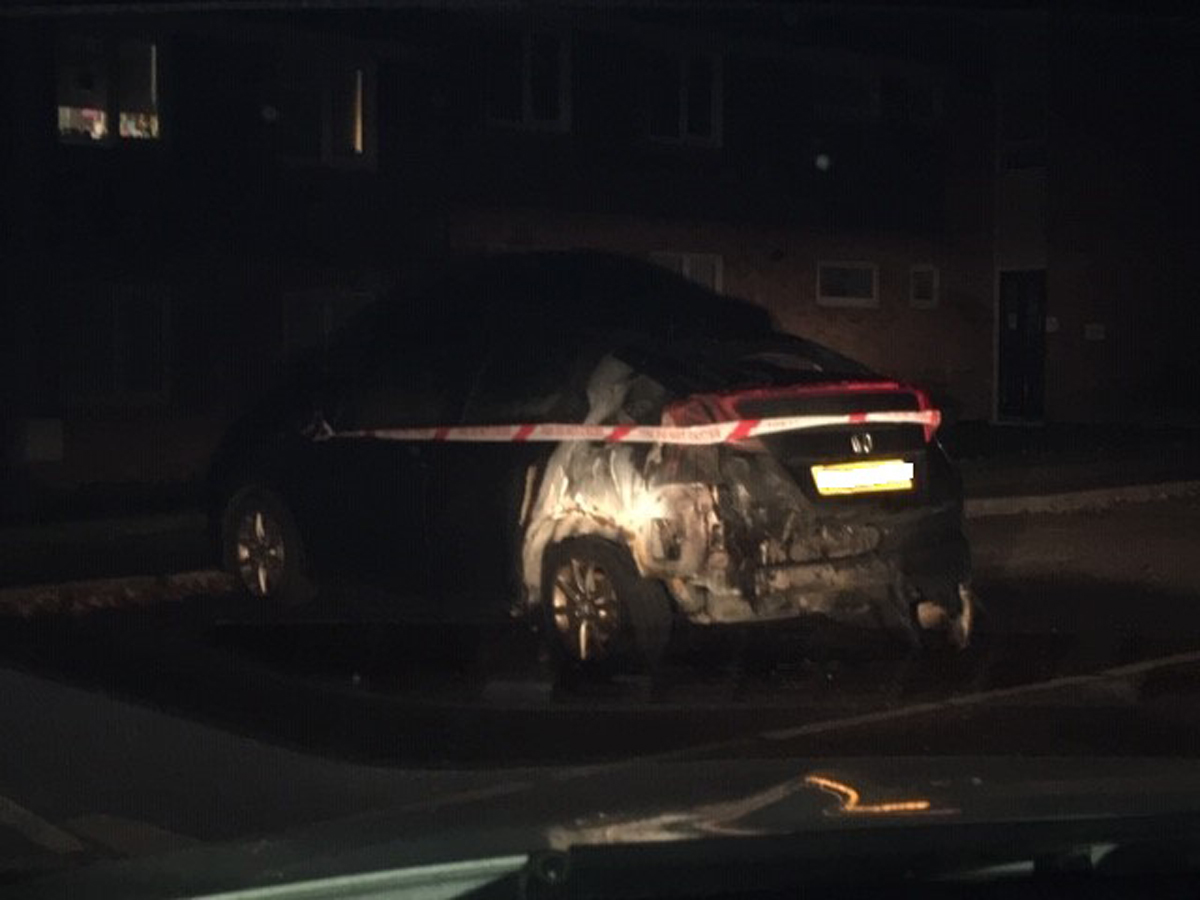 The black Honda Civic car was destroyed in the arson attack (Wiltshire Police/PA).