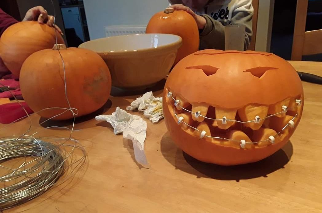 A pumpkin with braces on its teeth