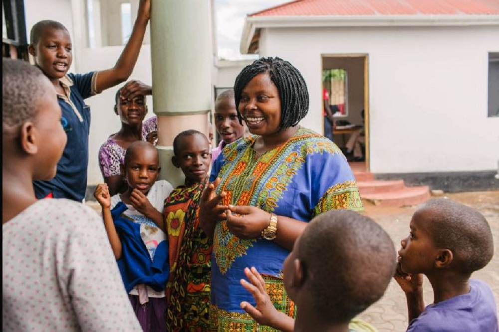 FGM survivor and activist Rhobi Samwelly with girls at the Mugumu safe house in Tanzania (Hope for Girls and Women/PA)