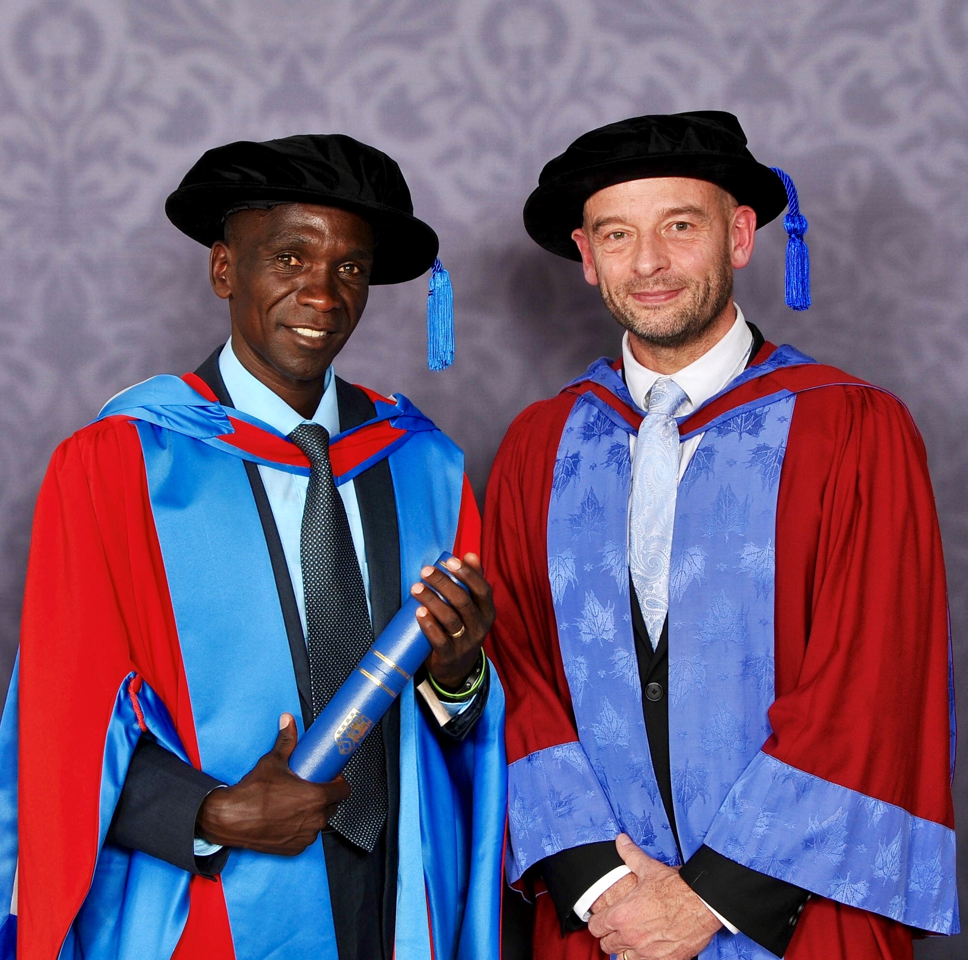 Eliud Kipchoge with Prof Andrew Jones as he receives an honorary degree from the University of Exeter last year (University of Exeter/PA).