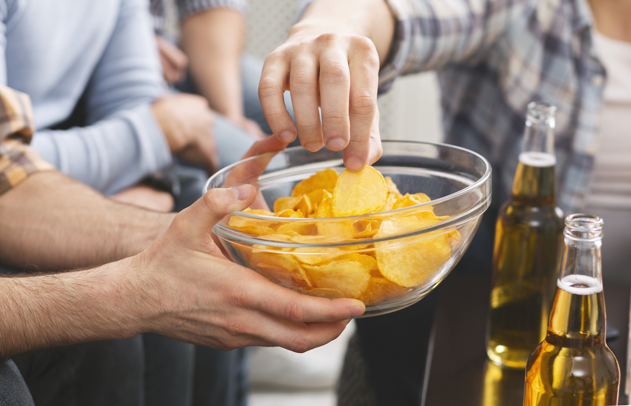 people sharing a bowl of crisps