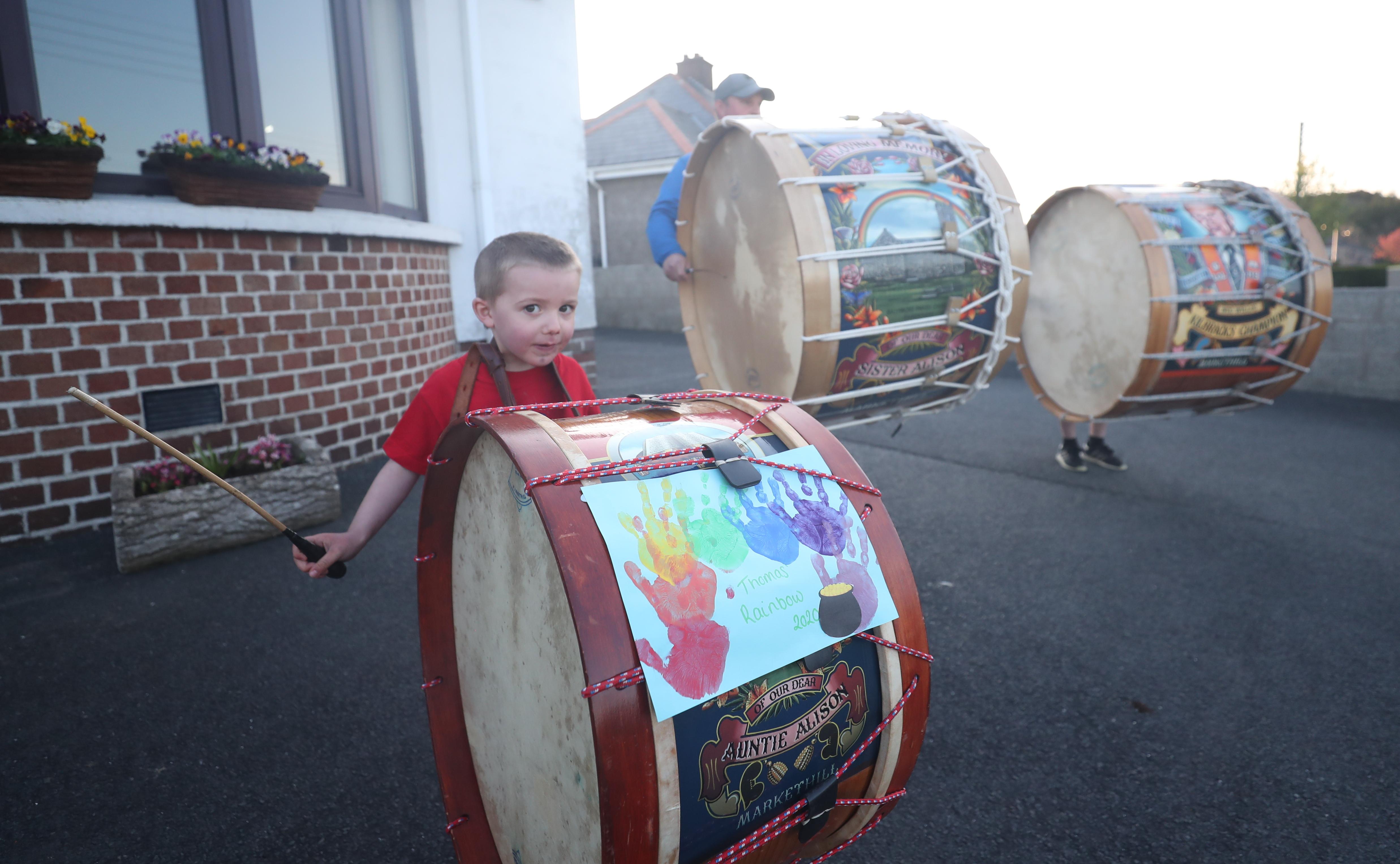 Boy bangs his drum