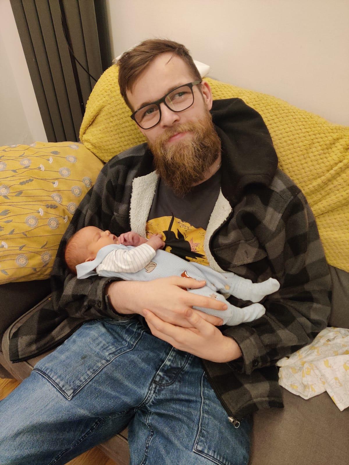 Brad Girvan with baby Finn