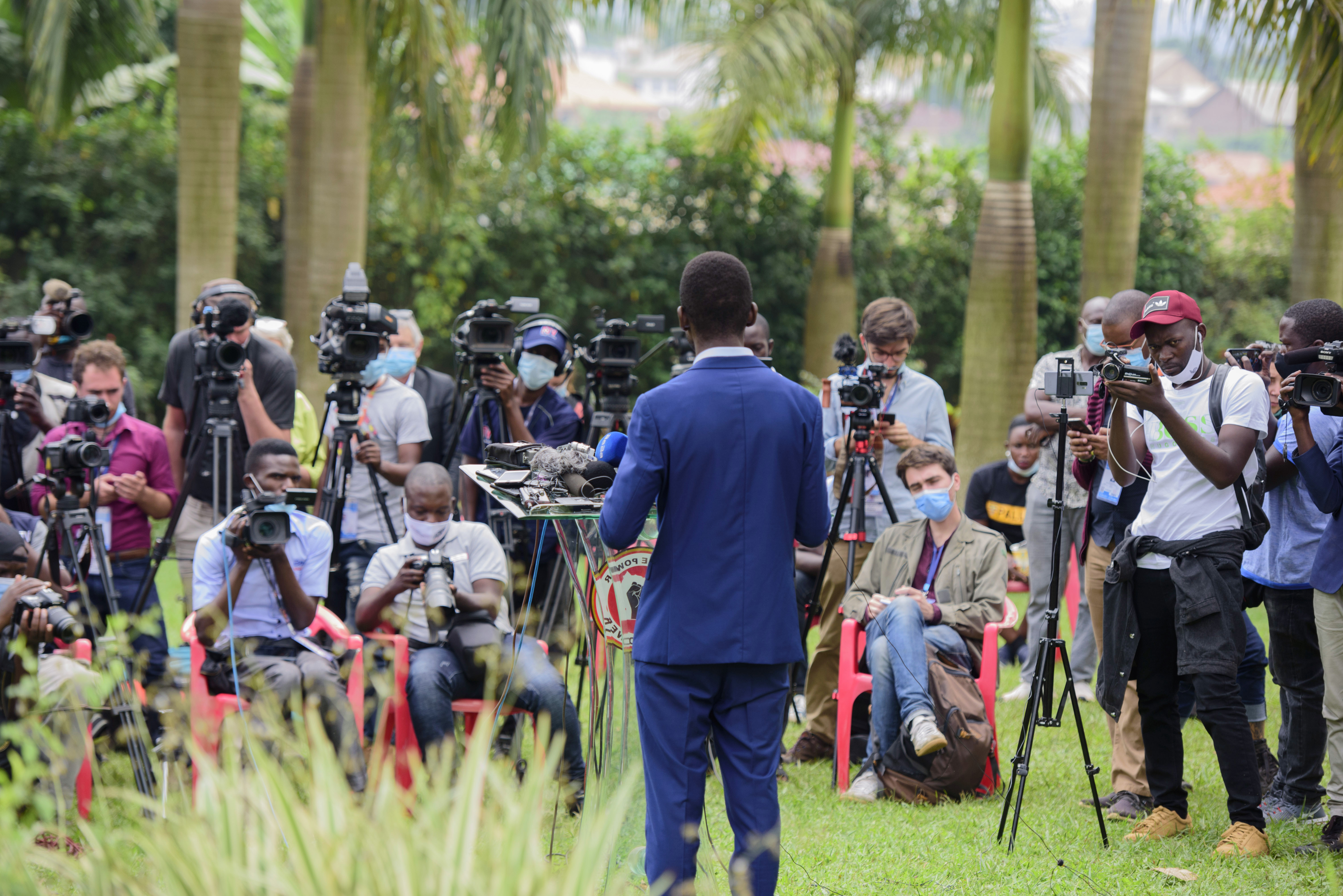 Mr Wine addresses the media at his home in Magere on Friday
