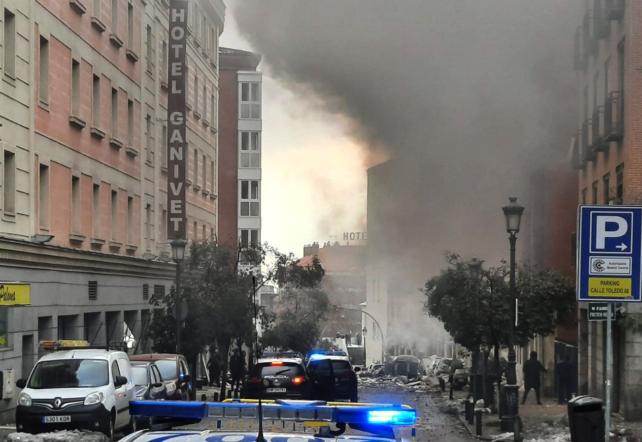 Smoke rises from a building and rubble scattered in Toledo Street following a explosion in central Madrid