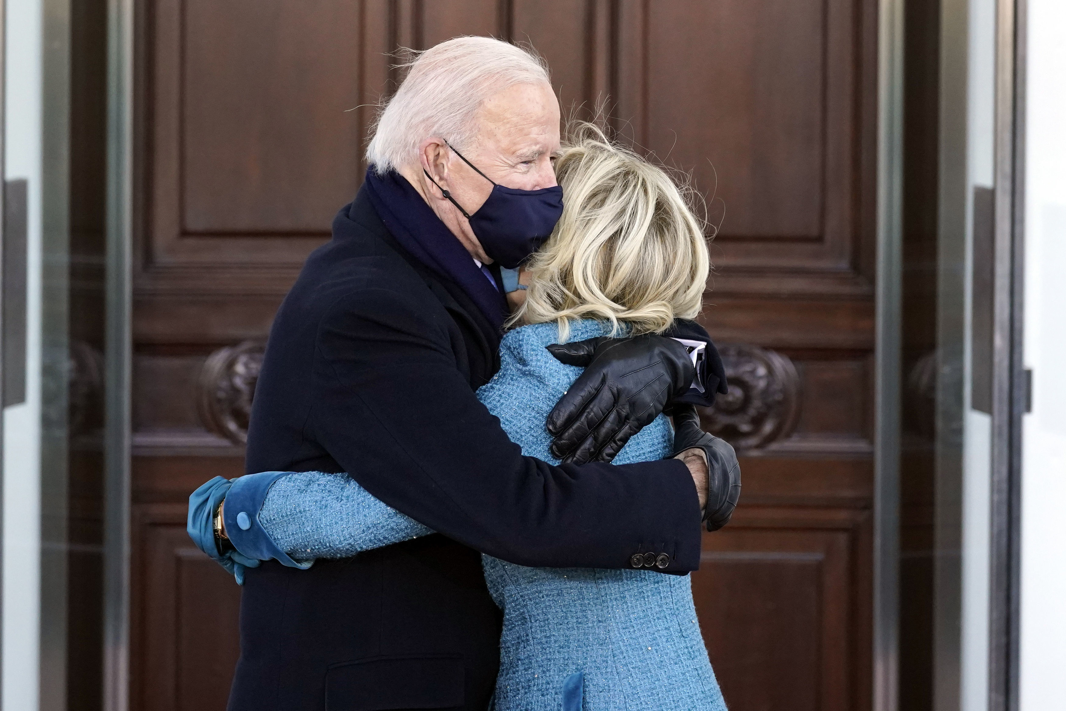 The Bidens hug outside the White House