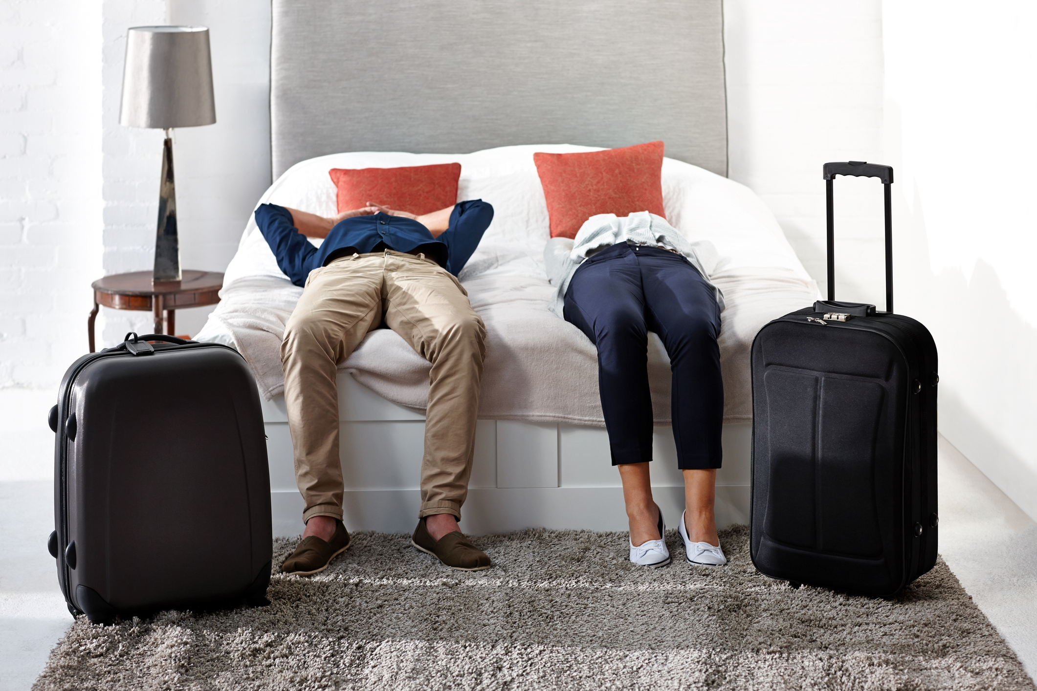 Couple lying on a hotel bed