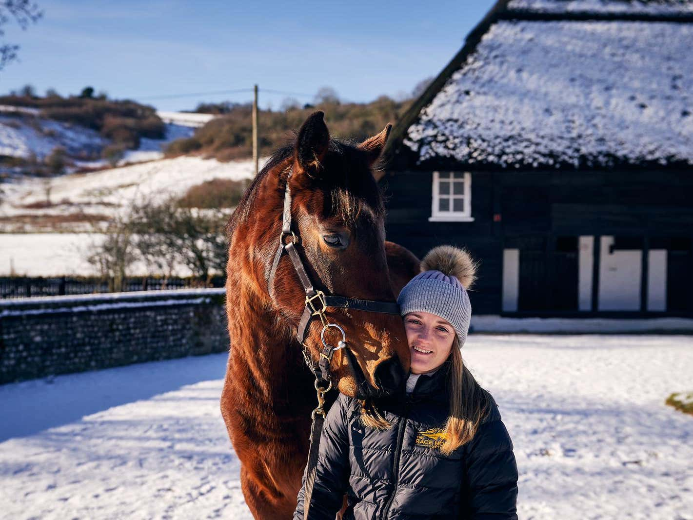 Hollie Doyle with the daughter of Postponed (Racehorse Lotto)