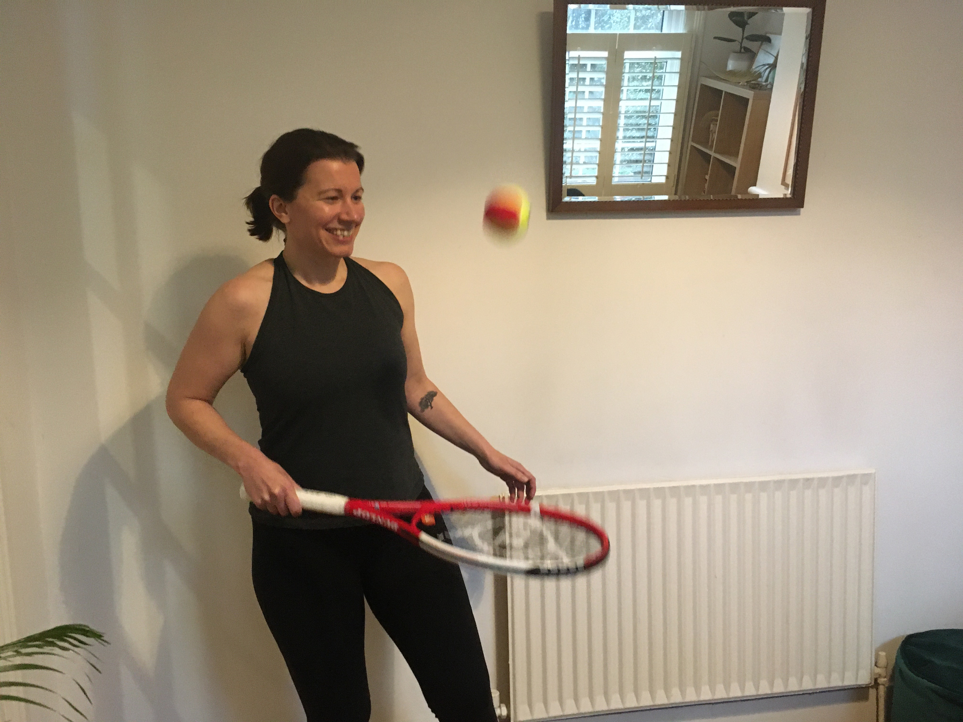 Abi Jackson doing a tennis workout at home