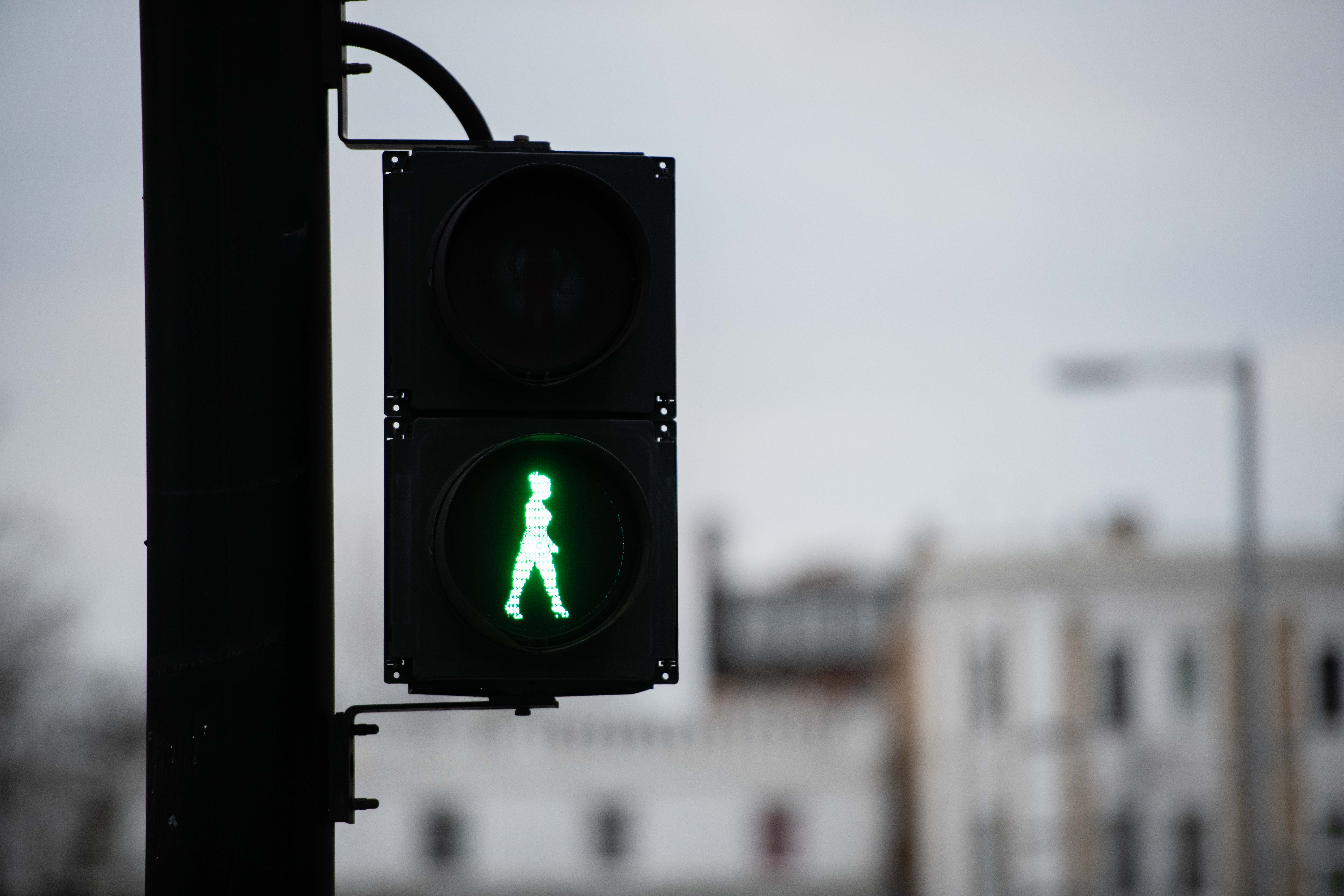 Green woman at the lights