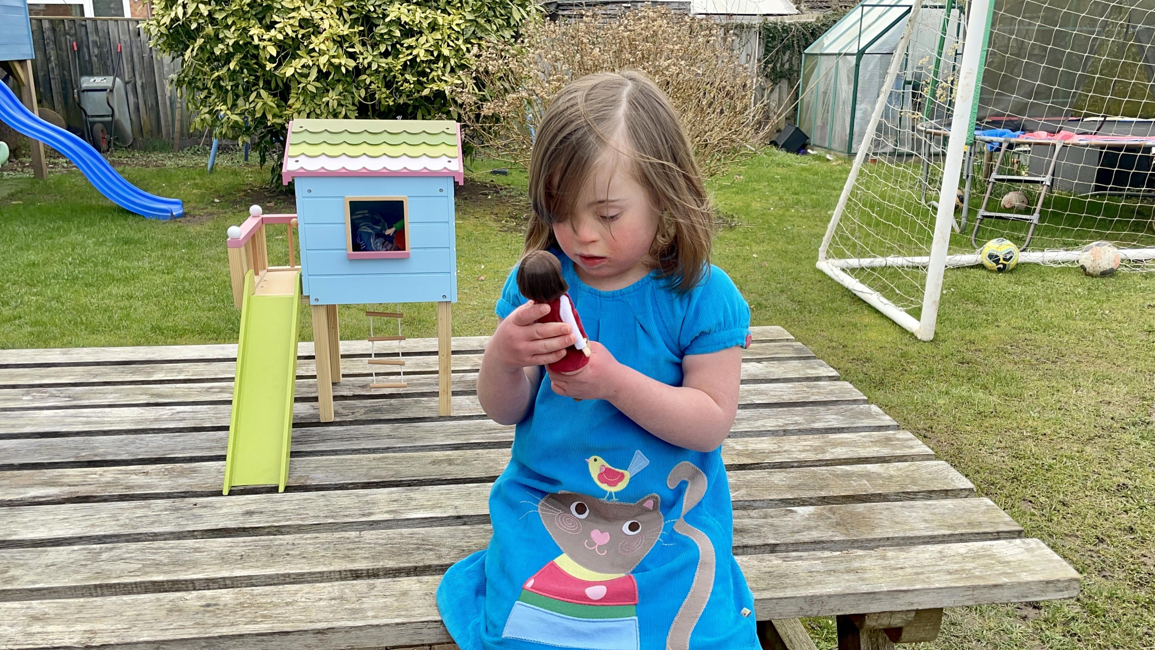 Rosie Barnett, 6, with a new Lottie Dolls toy