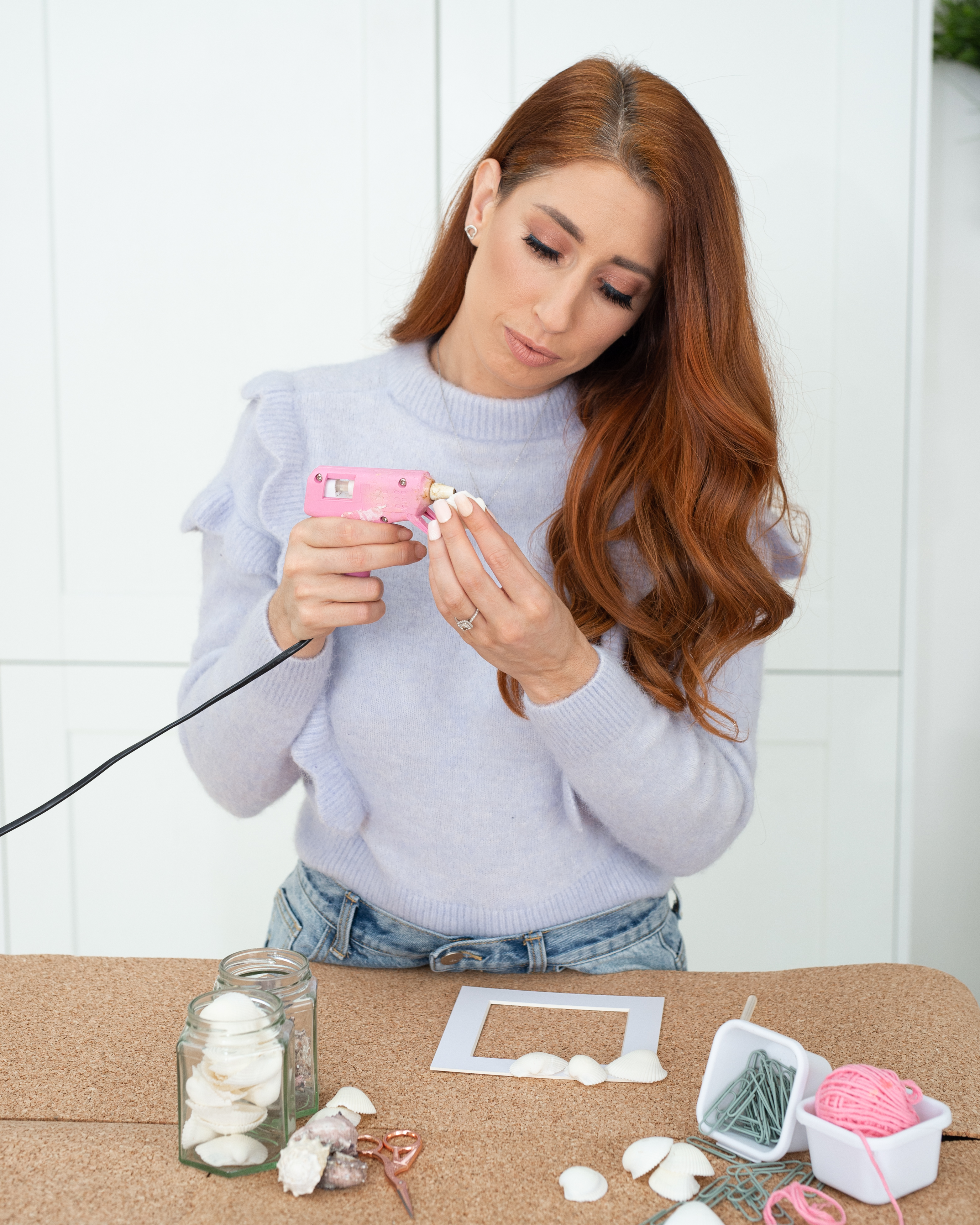Stacey Solomon doing one of the crafting projects in her new Tap To Tidy book