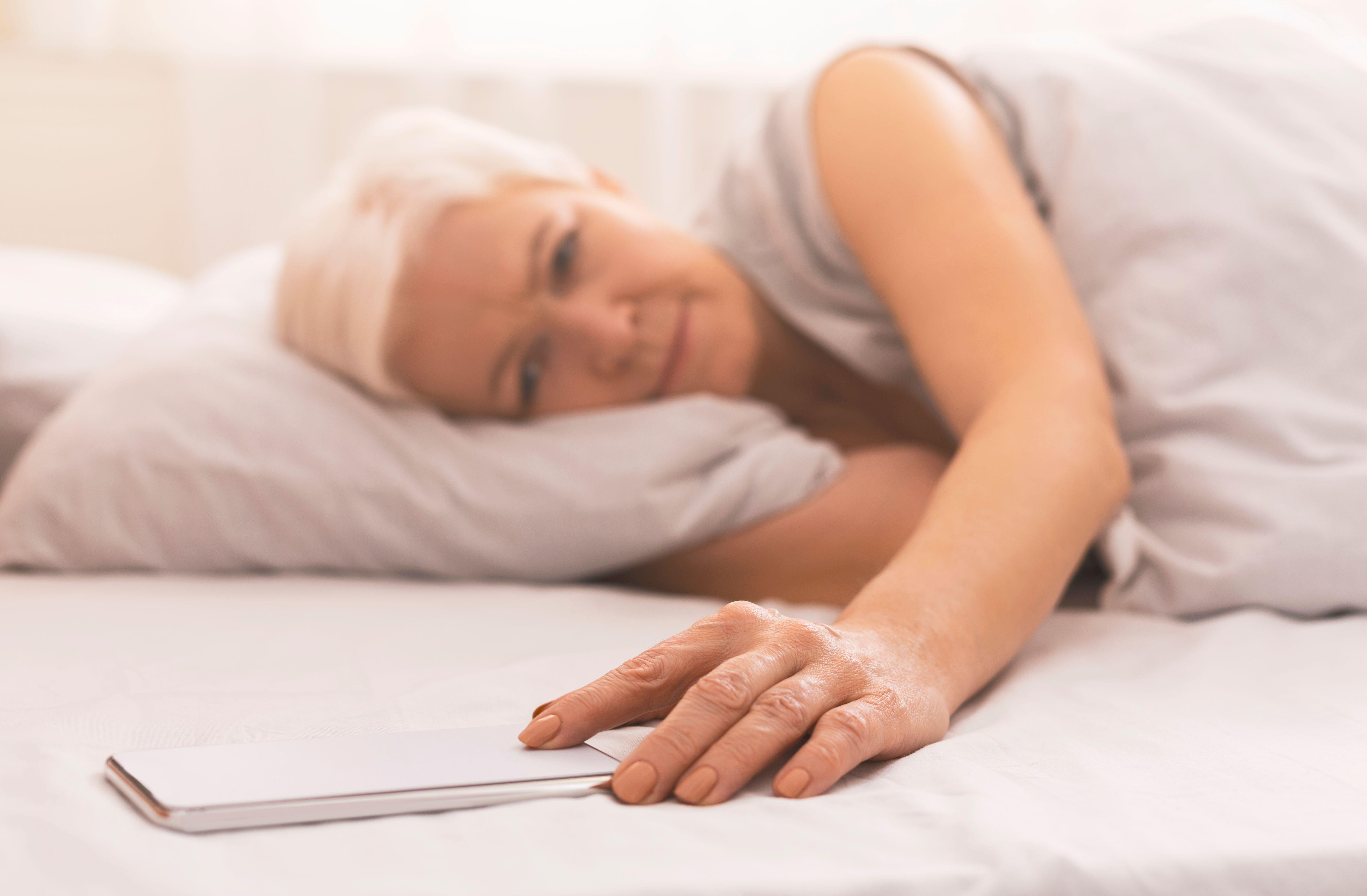 Woman tired in bed