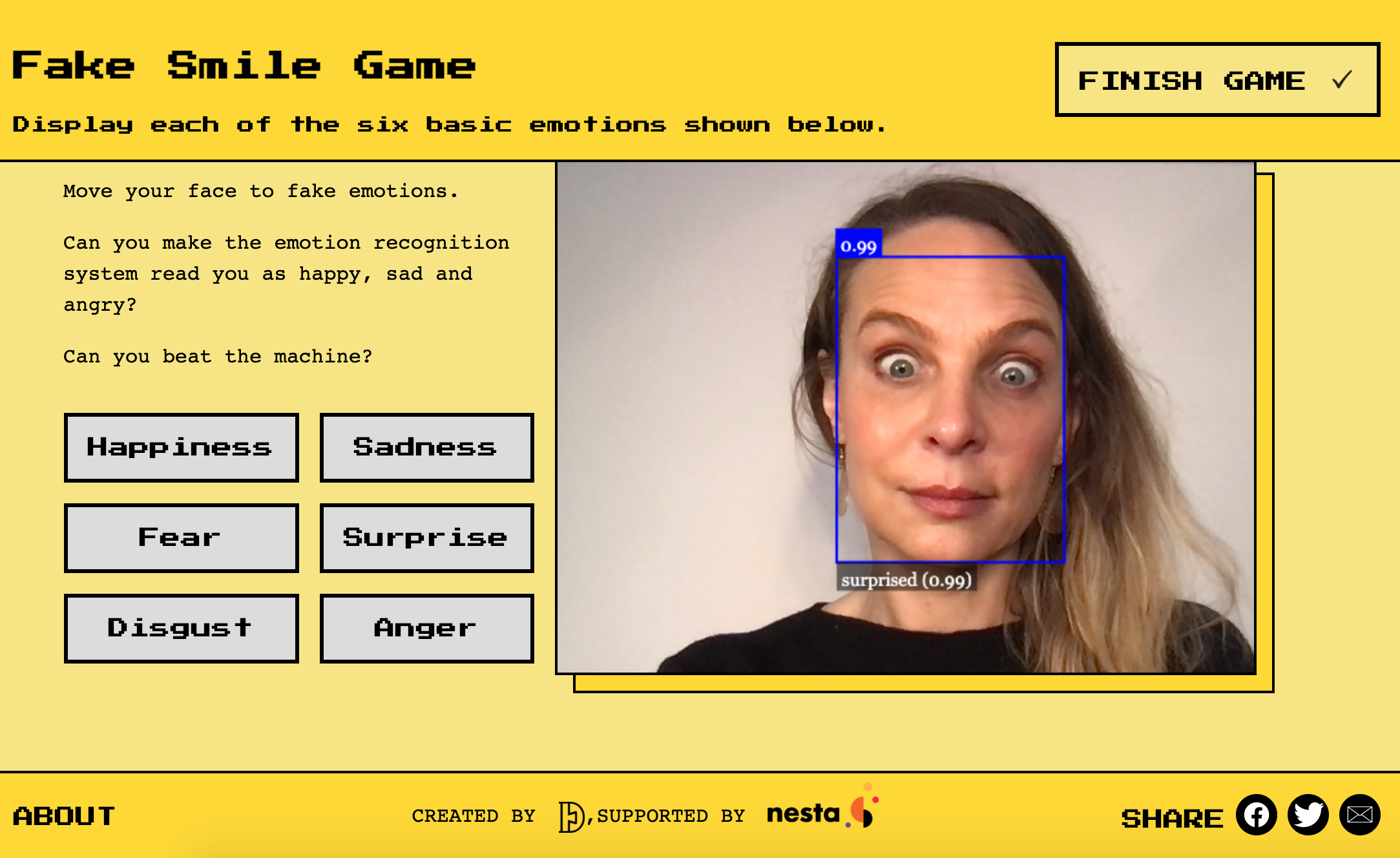 Dr Alexa Hagerty plays a game on the Emojify website, which demonstrates AI emotion recognition technology. (Cambridge University/ PA)