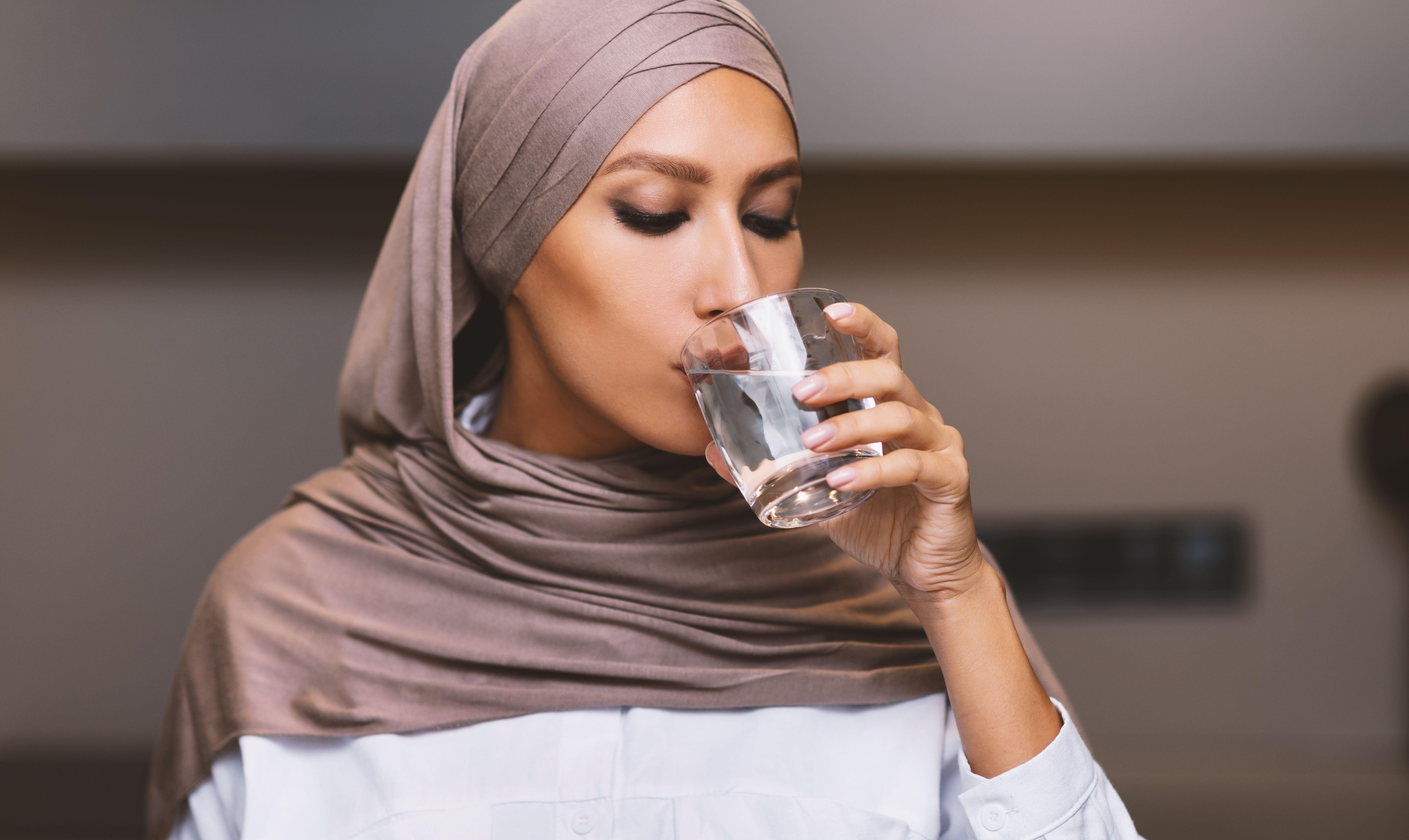 Muslim Woman Drinking Water