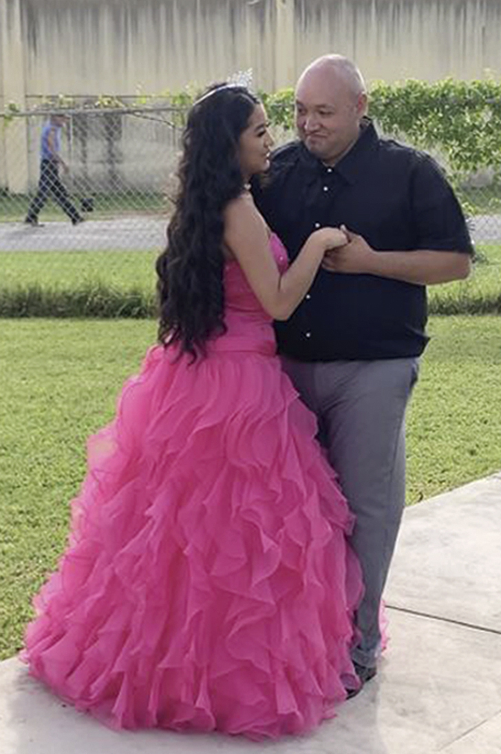 Adriana Palma wears a tiara and ballgown as she dances with her father, Noe Ramirez Huerta, on her quinceanera, her 15th birthday celebration