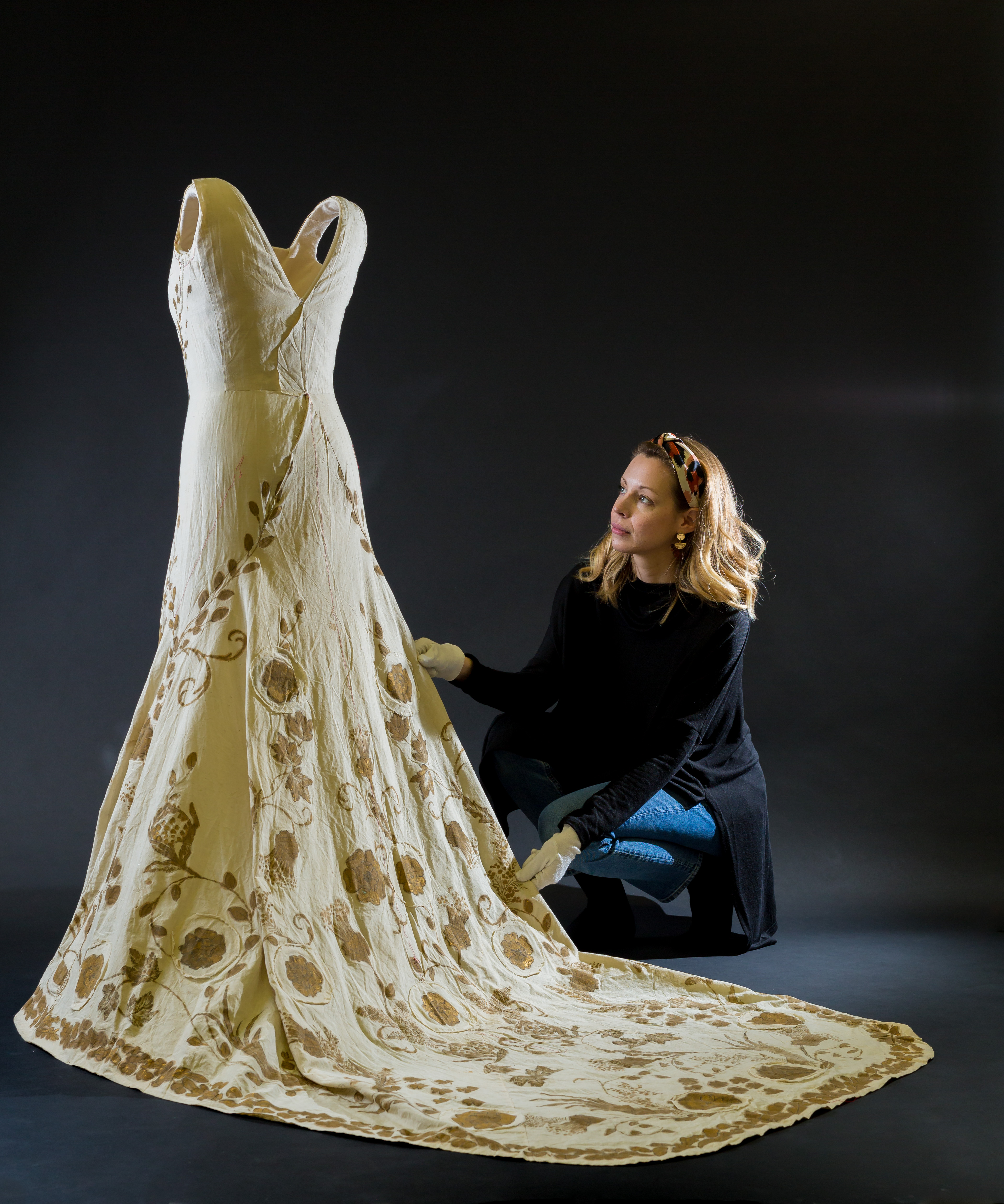 Historic Royal Palaces conservator prepares Queen Elizabeth The Queen Mother's coronation gown toile for display