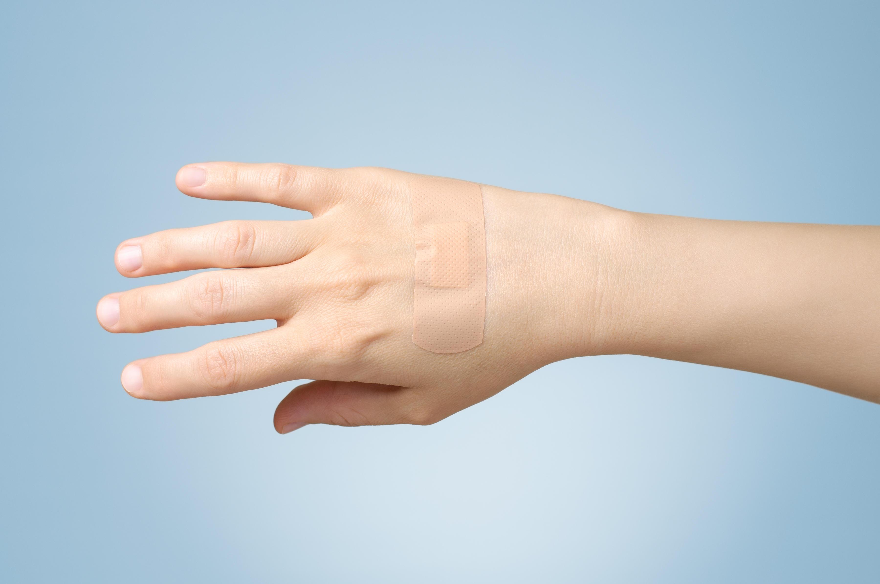 Plaster on female hand