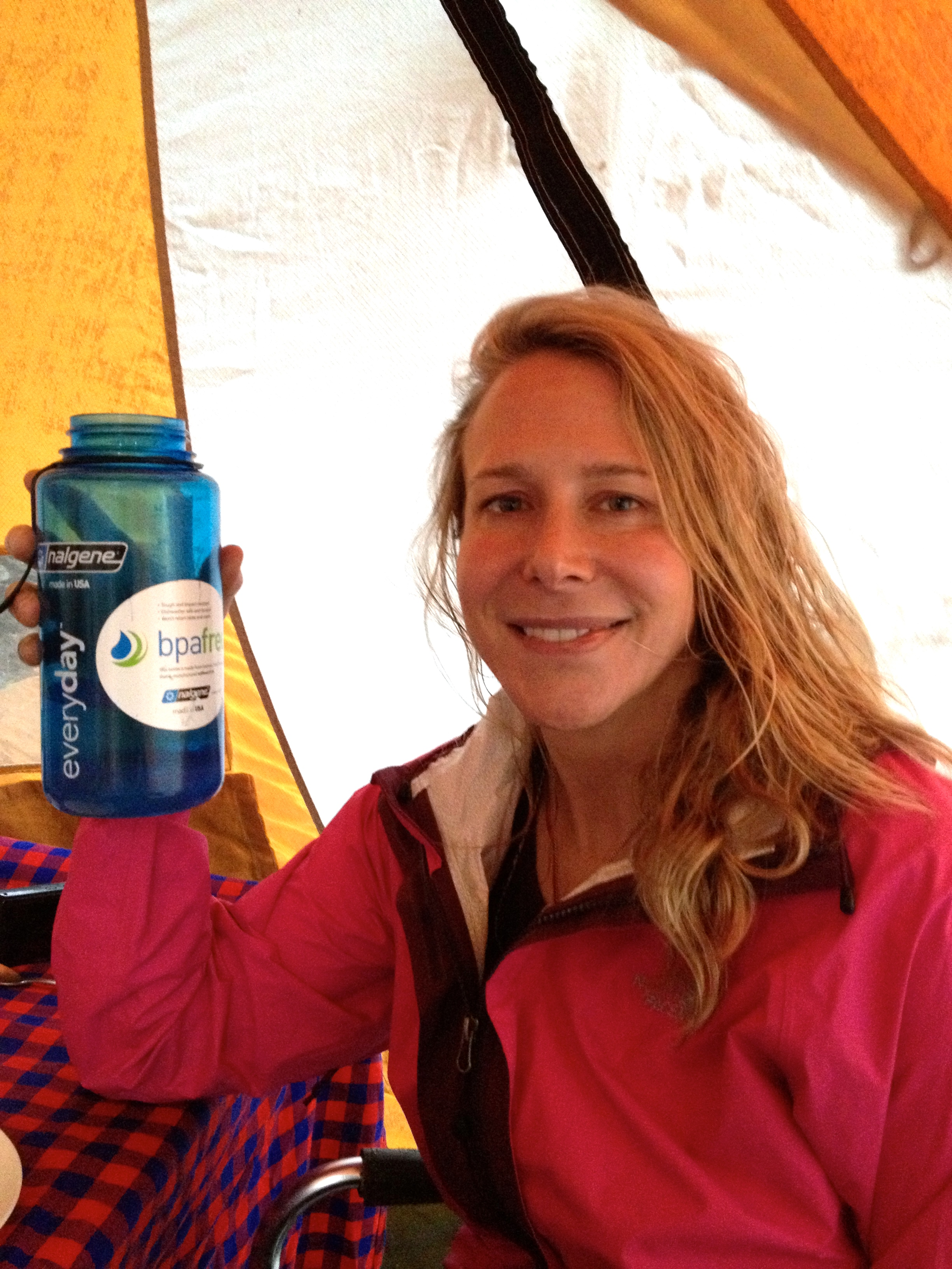 Vanessa holds a bottle at Mount Kilimanjaro - she is wearing a pink jacket, holding a blue bottle  - 8c0d2151 6e0c 4e11 b19a c72ef1628128 - 'I could never say no to space': British-American explorer aims for the stars